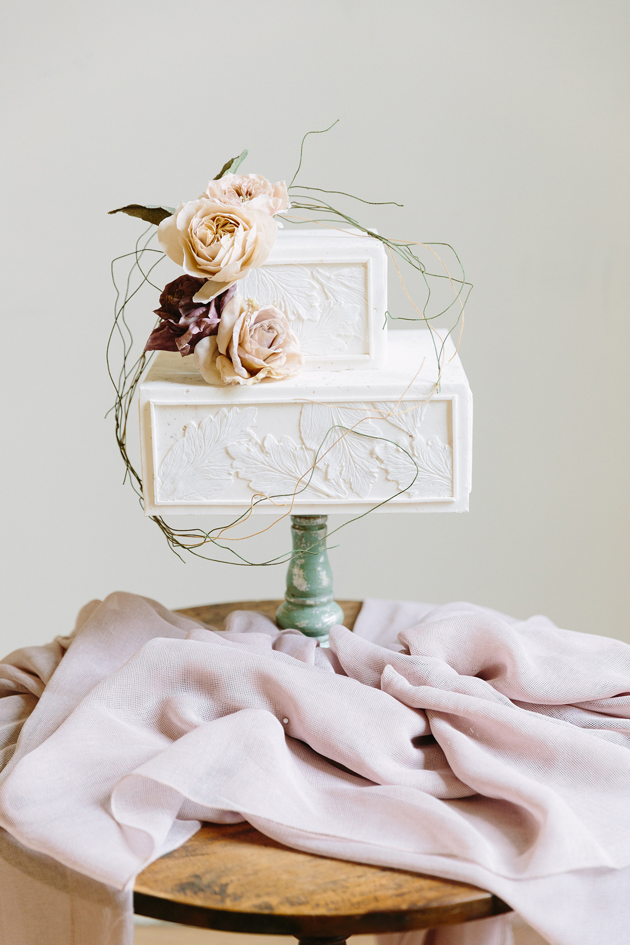 twig branch and flowers on square wedding cake
