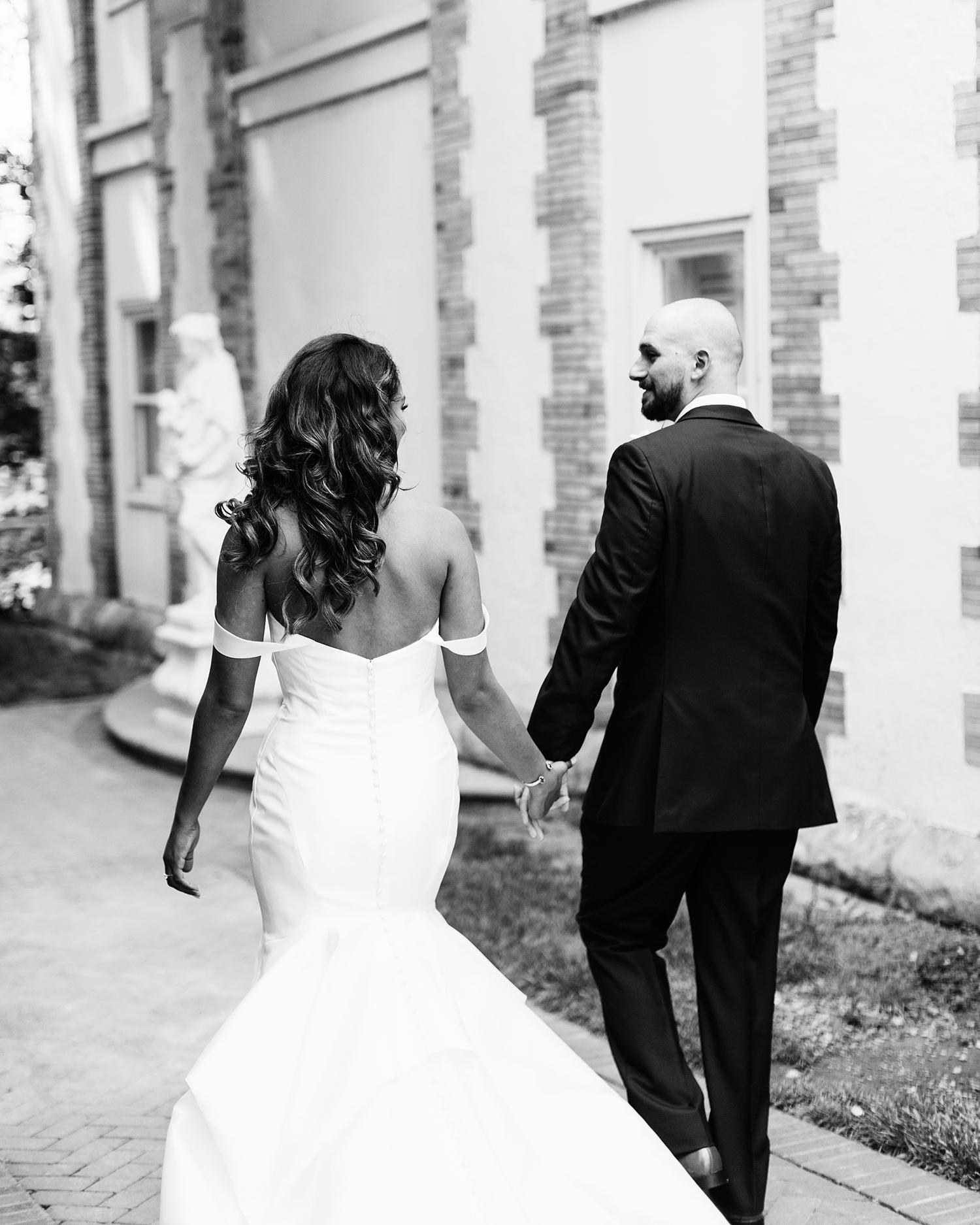 bryanna nick wedding couple bride groom holding hands