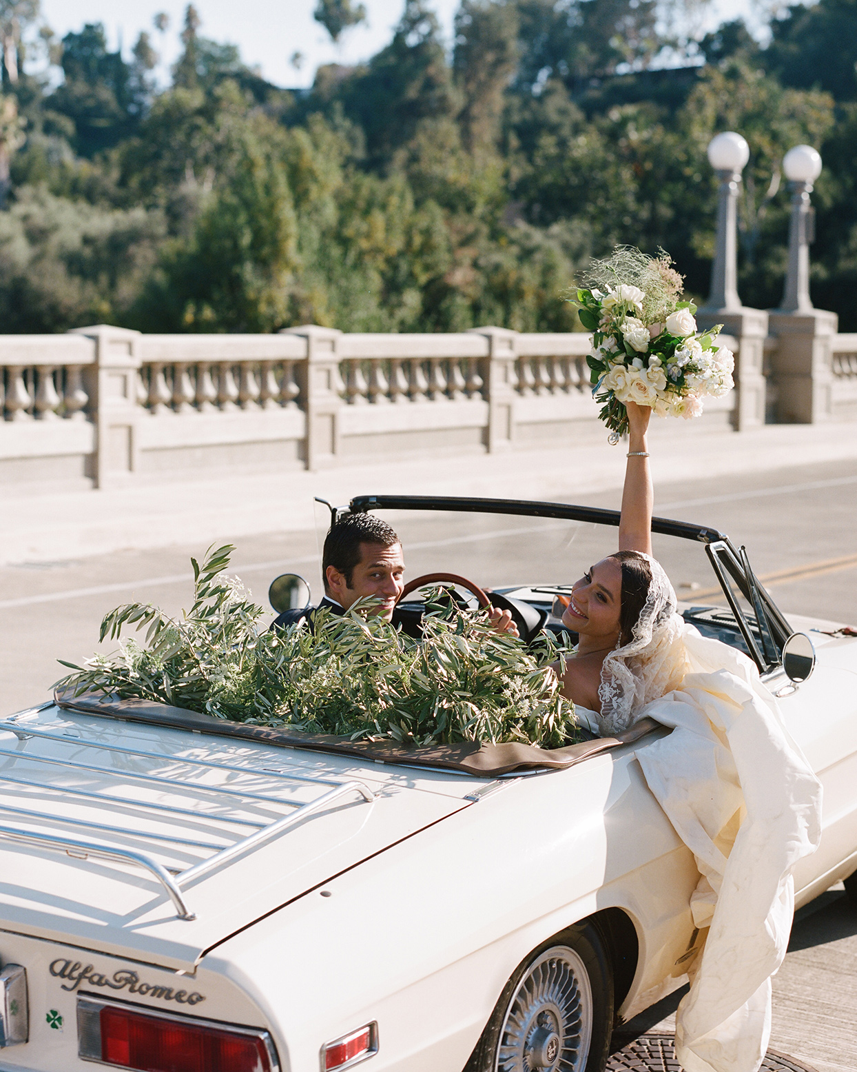 pia davide wedding couple in getaway car