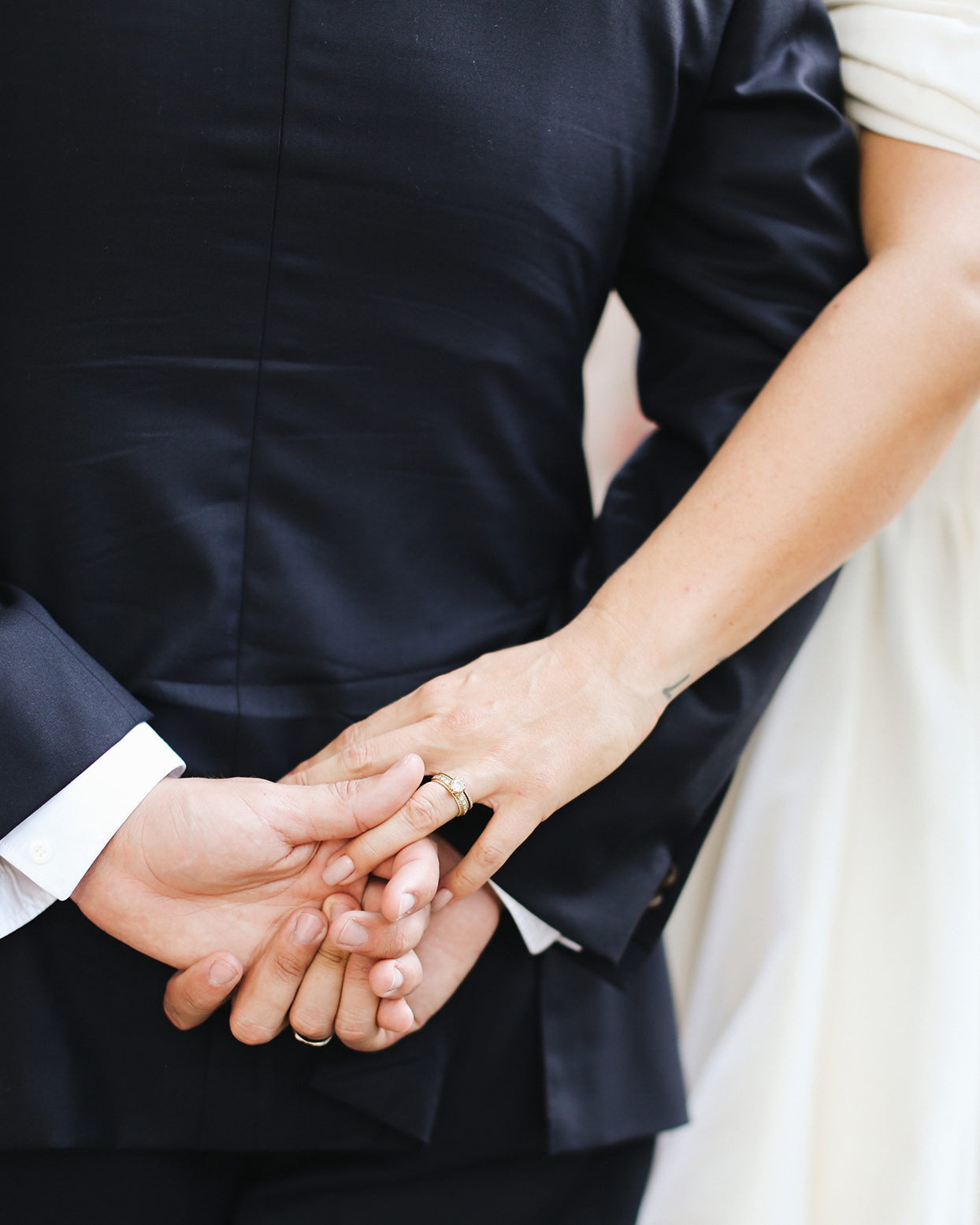 pia davide wedding couple hands with rings