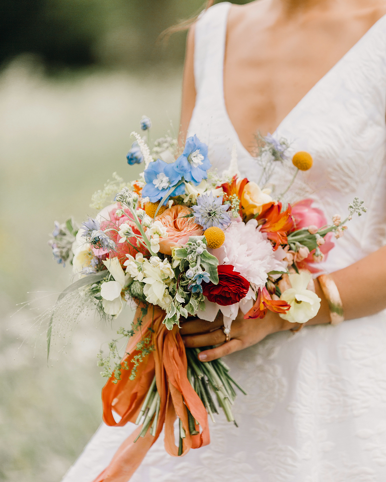 brides bright colored floral bouquet with silk ribbon