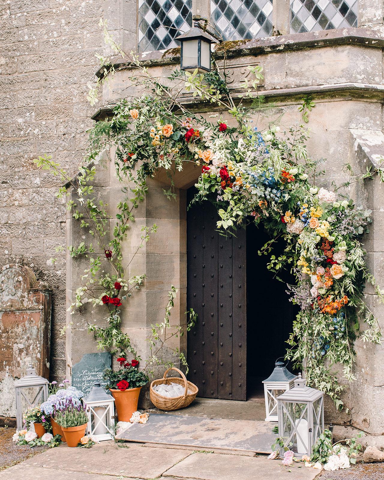 church entrance floral arrangement arch