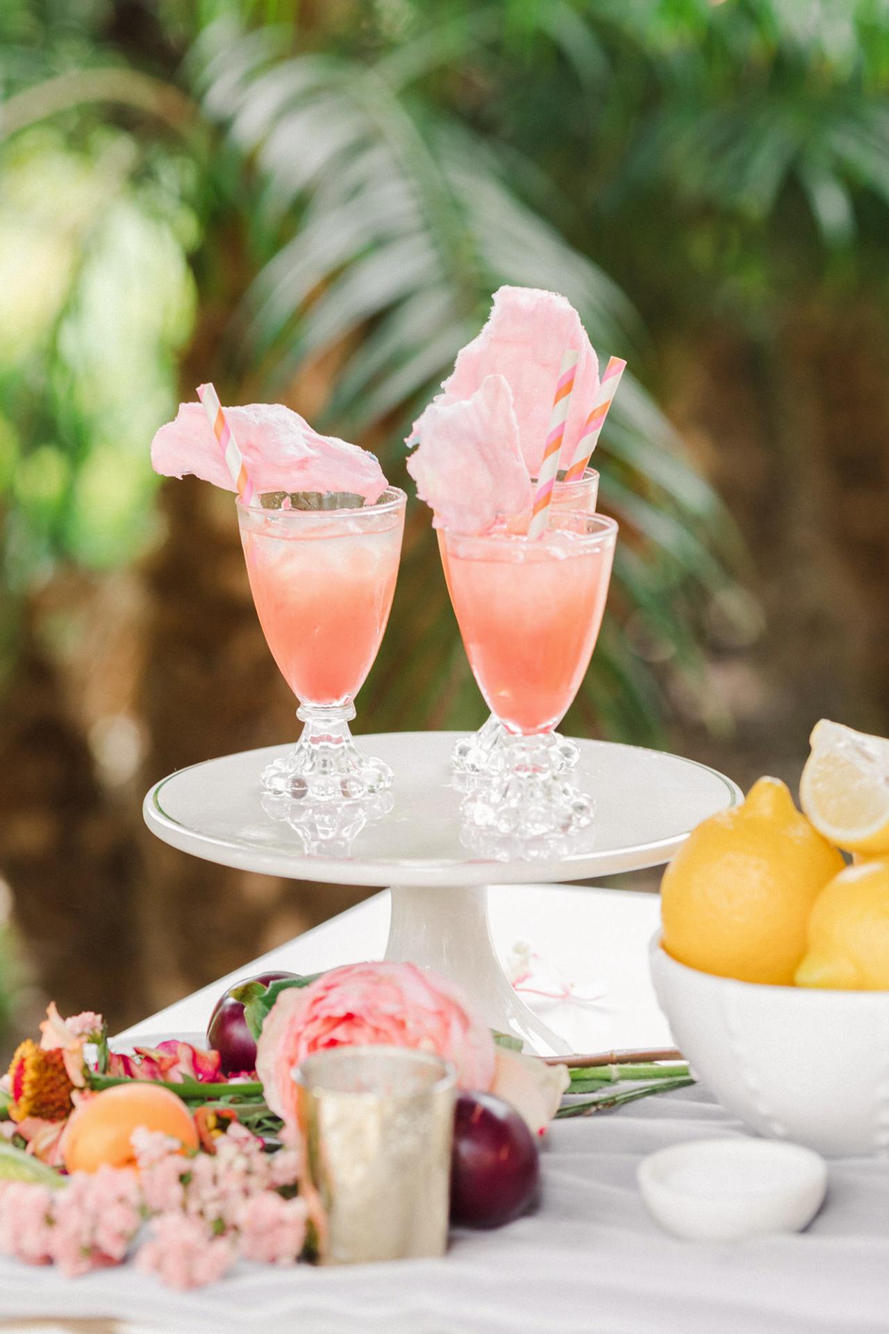 carnival inspired cocktails on dessert stand
