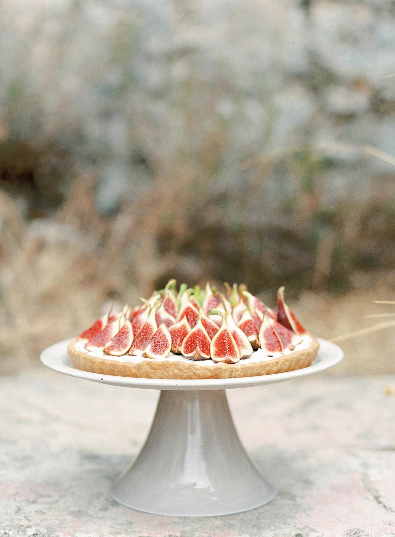 fresh fig fruit tart on dessert stand