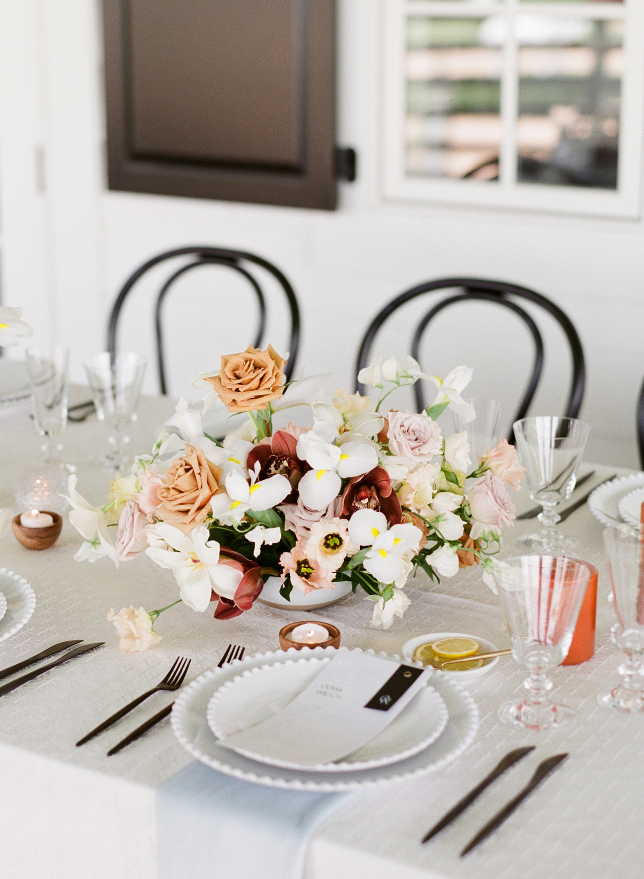 assorted flower centerpiece black and white table setting