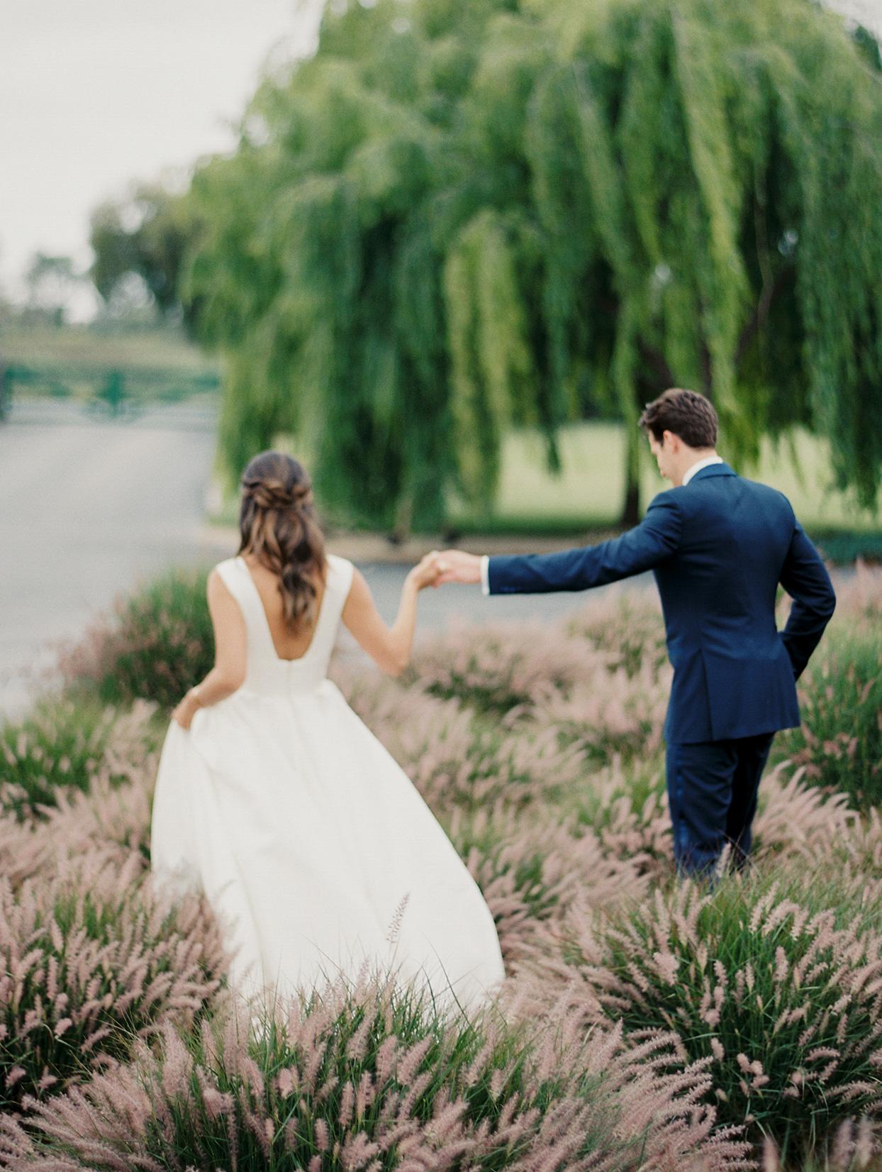mika steve wedding couple walking through field