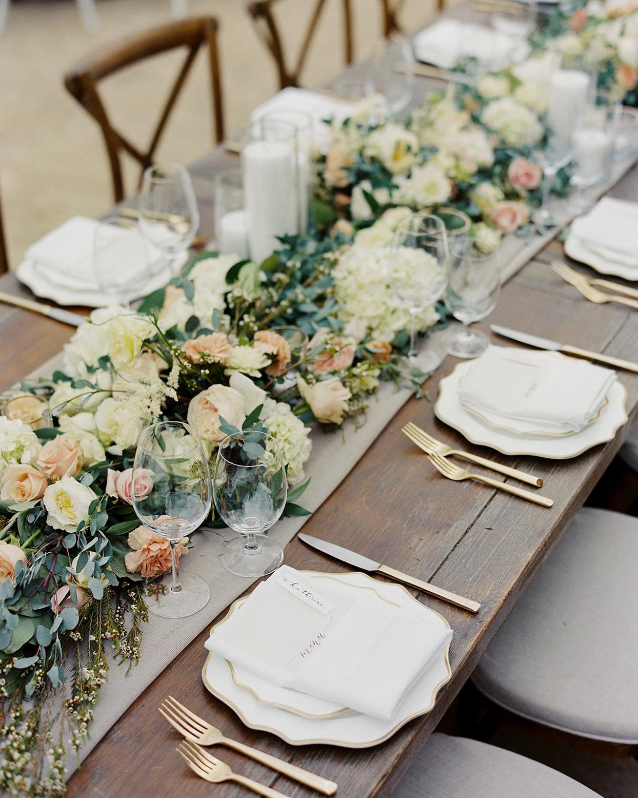 mika steve wedding garland centerpiece on rustic table