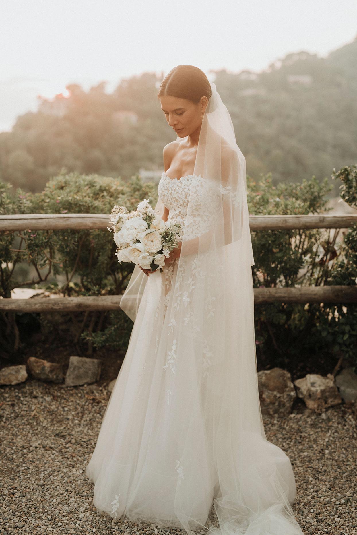 jaclyn antonio wedding bride in elegant lace and tool dress