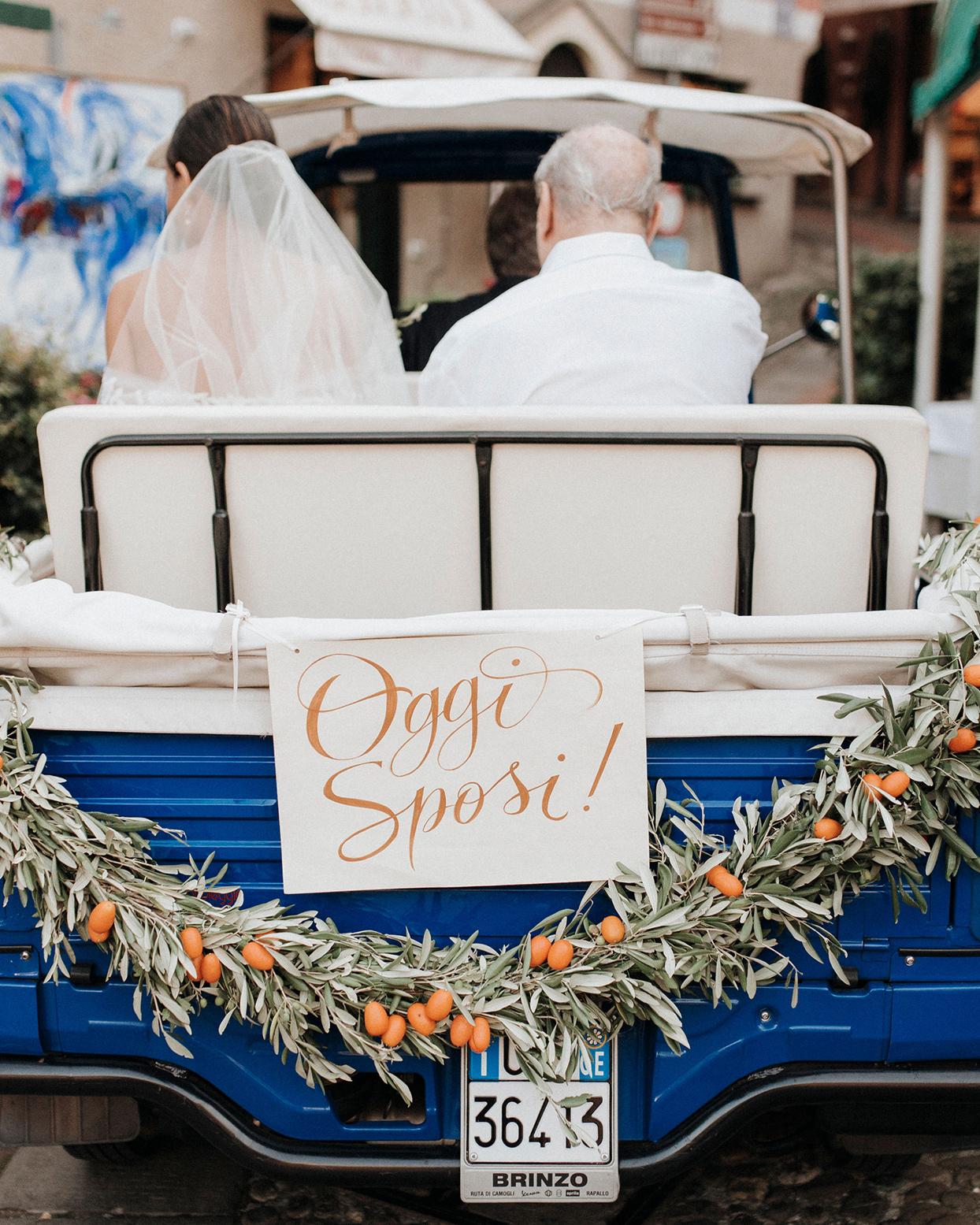 jaclyn antonio wedding bride and father in cart