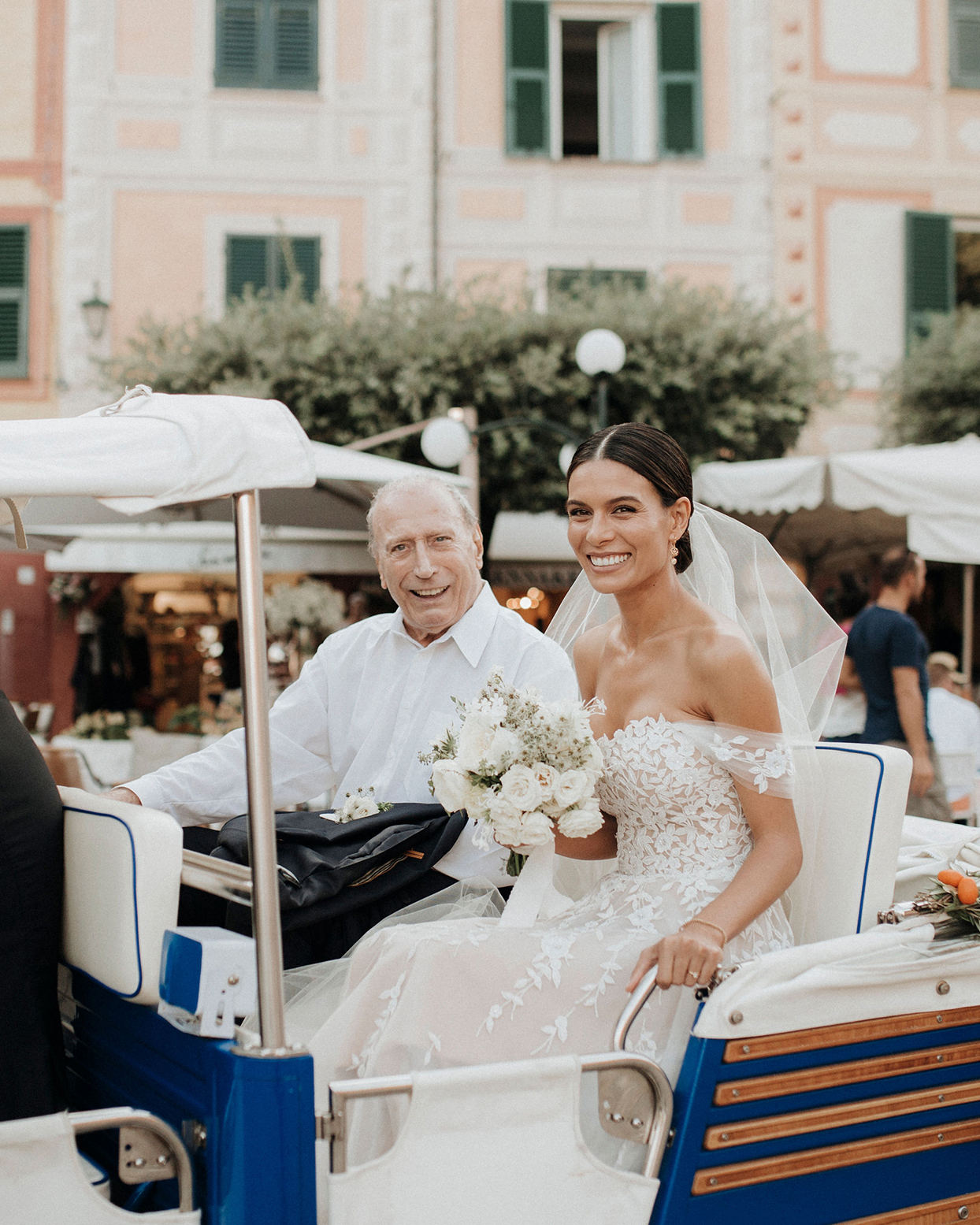 jaclyn antonio wedding bride and father in cart smiling