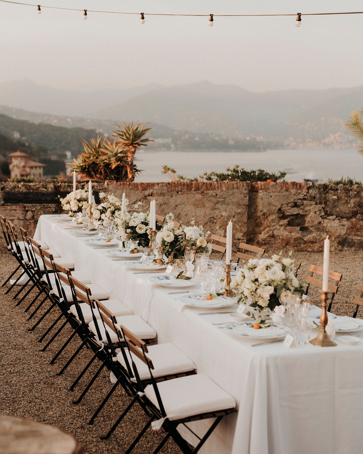 jaclyn antonio wedding reception long table overlooking water
