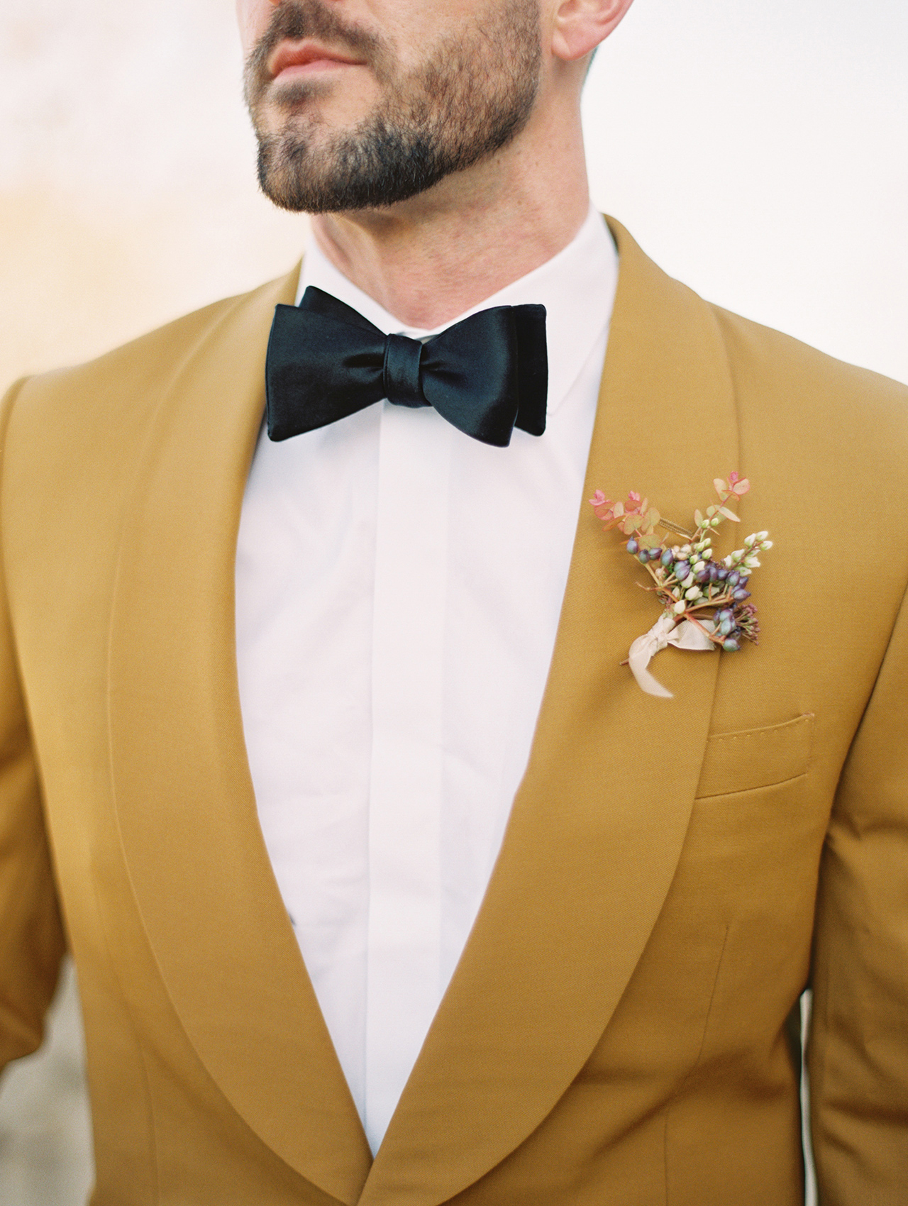 ochre-hued grooms tuxedo jacket