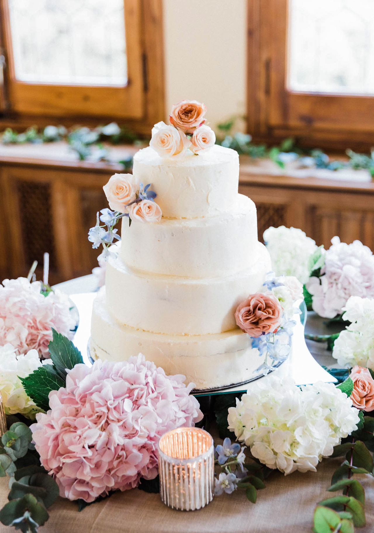 four tier wedding cake with floral arrangement