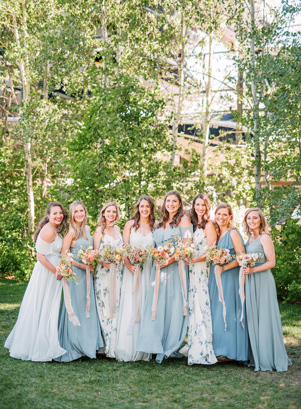 bride bridesmaids light blue dresses outdoors