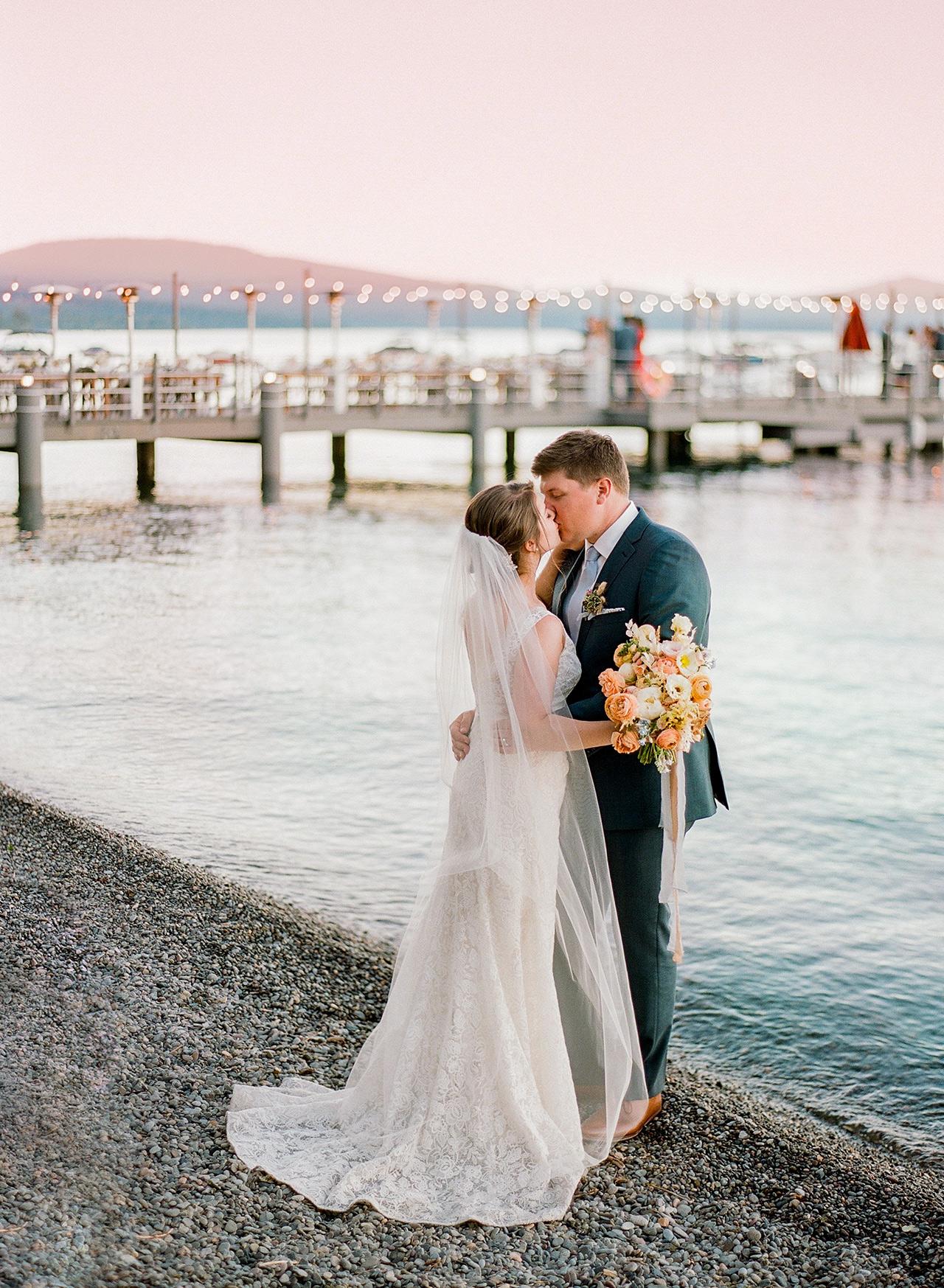wedding couple kiss lake beach dock view