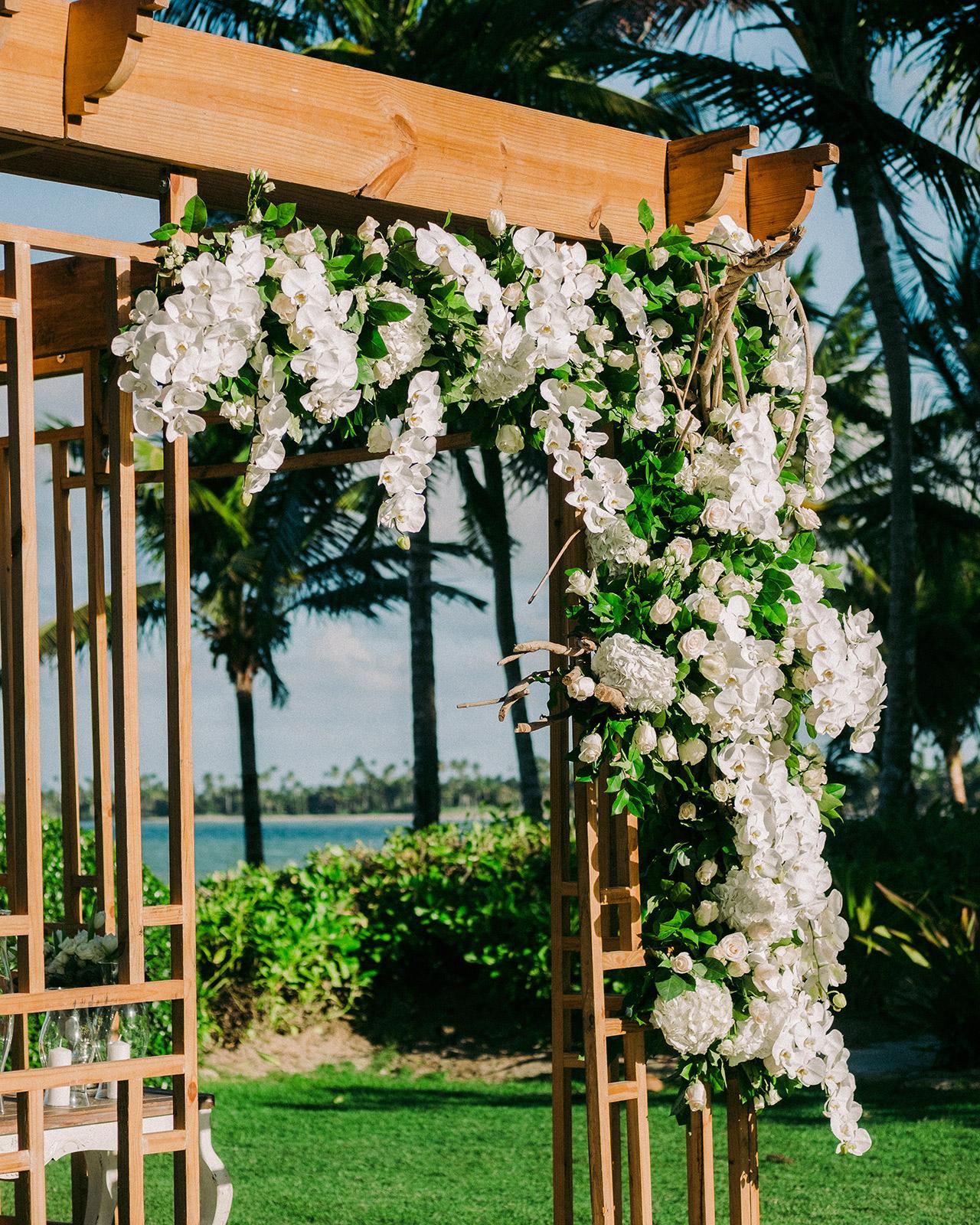 wedding wooden archway white flower green foliage garlands