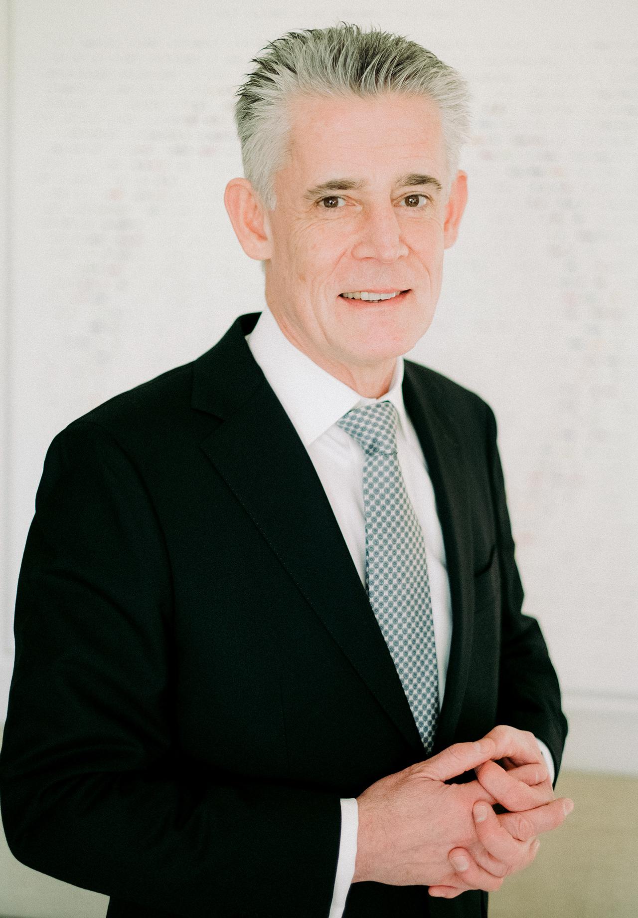 groom European-cut black suit patterned tie