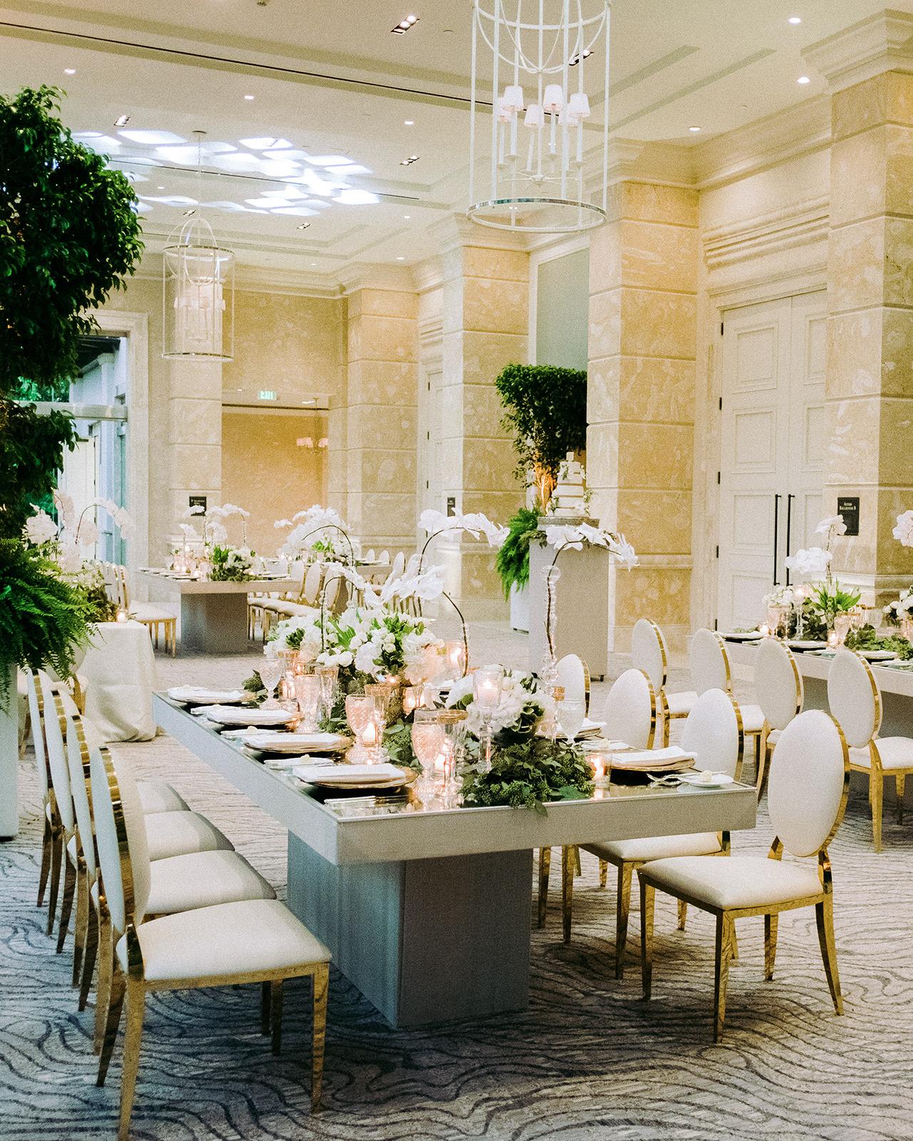 wedding reception ballroom rectangular tables gold chairs