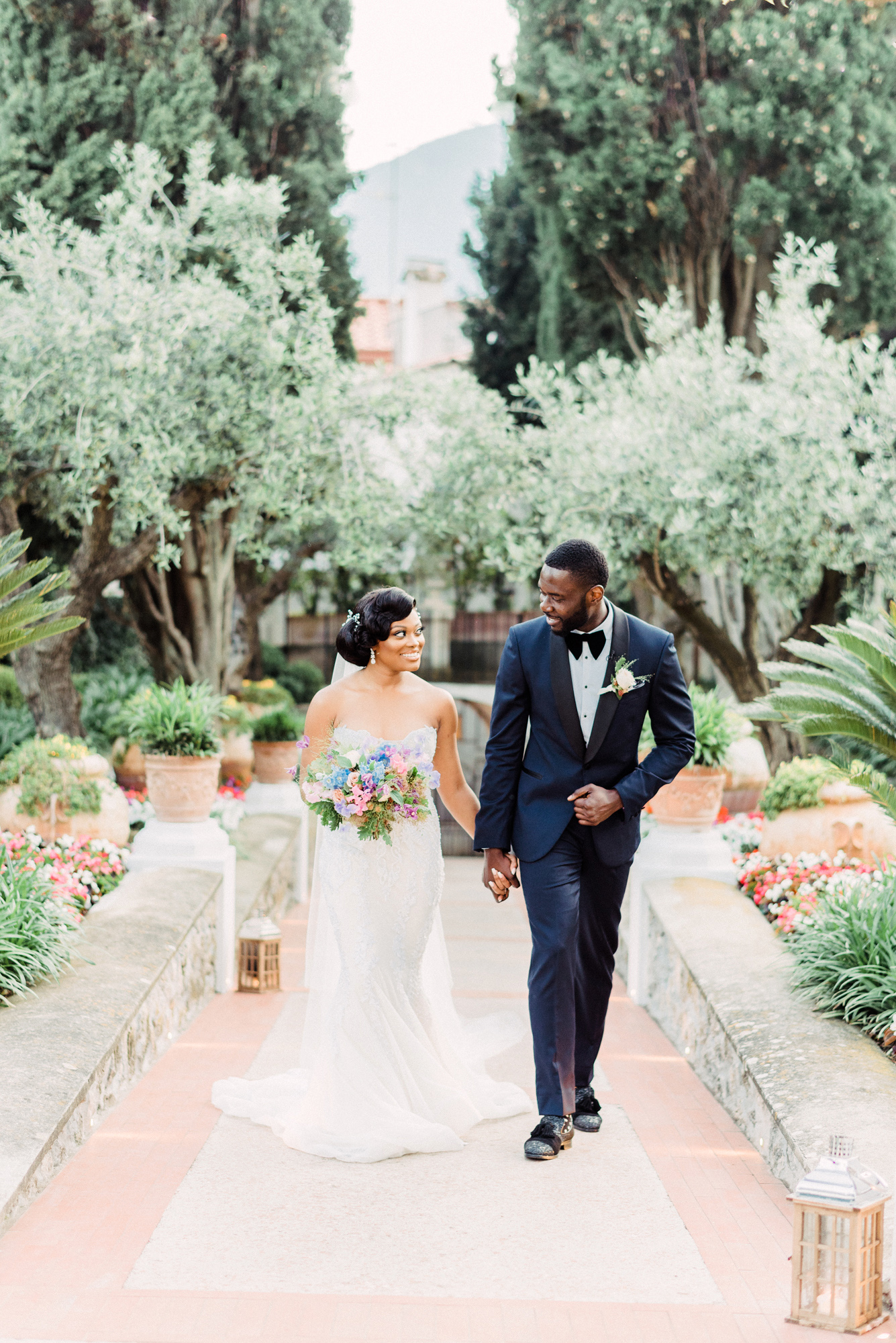onome efe wedding couple walking holding hands