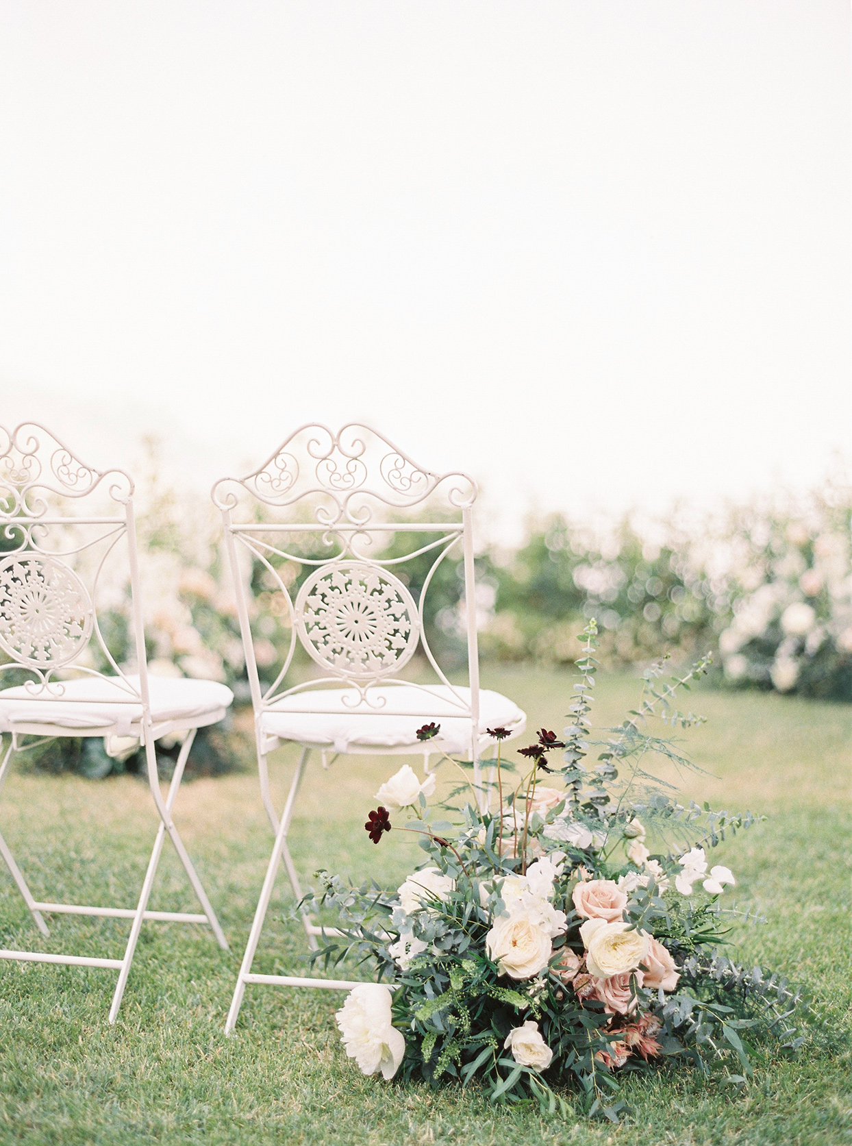 krystyna alexander wedding white ceremony chairs and flowers