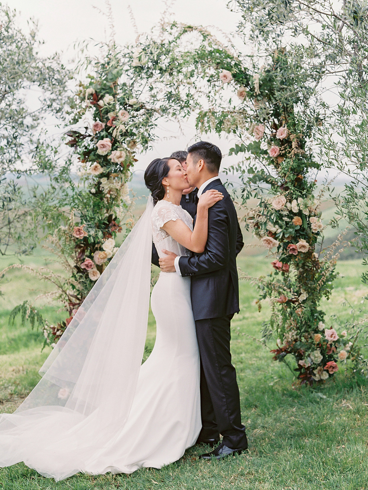 jen alan wedding kiss under arch