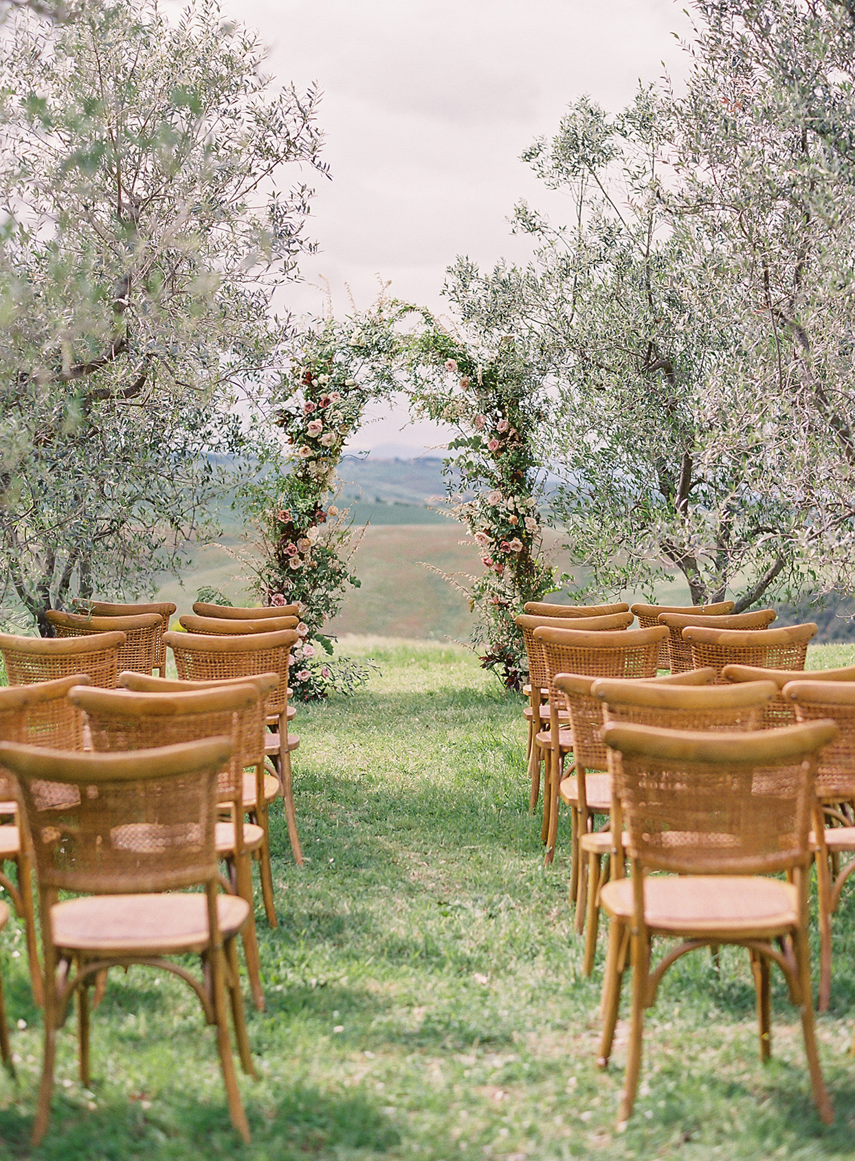 jen alan wedding ceremony location with floral arch