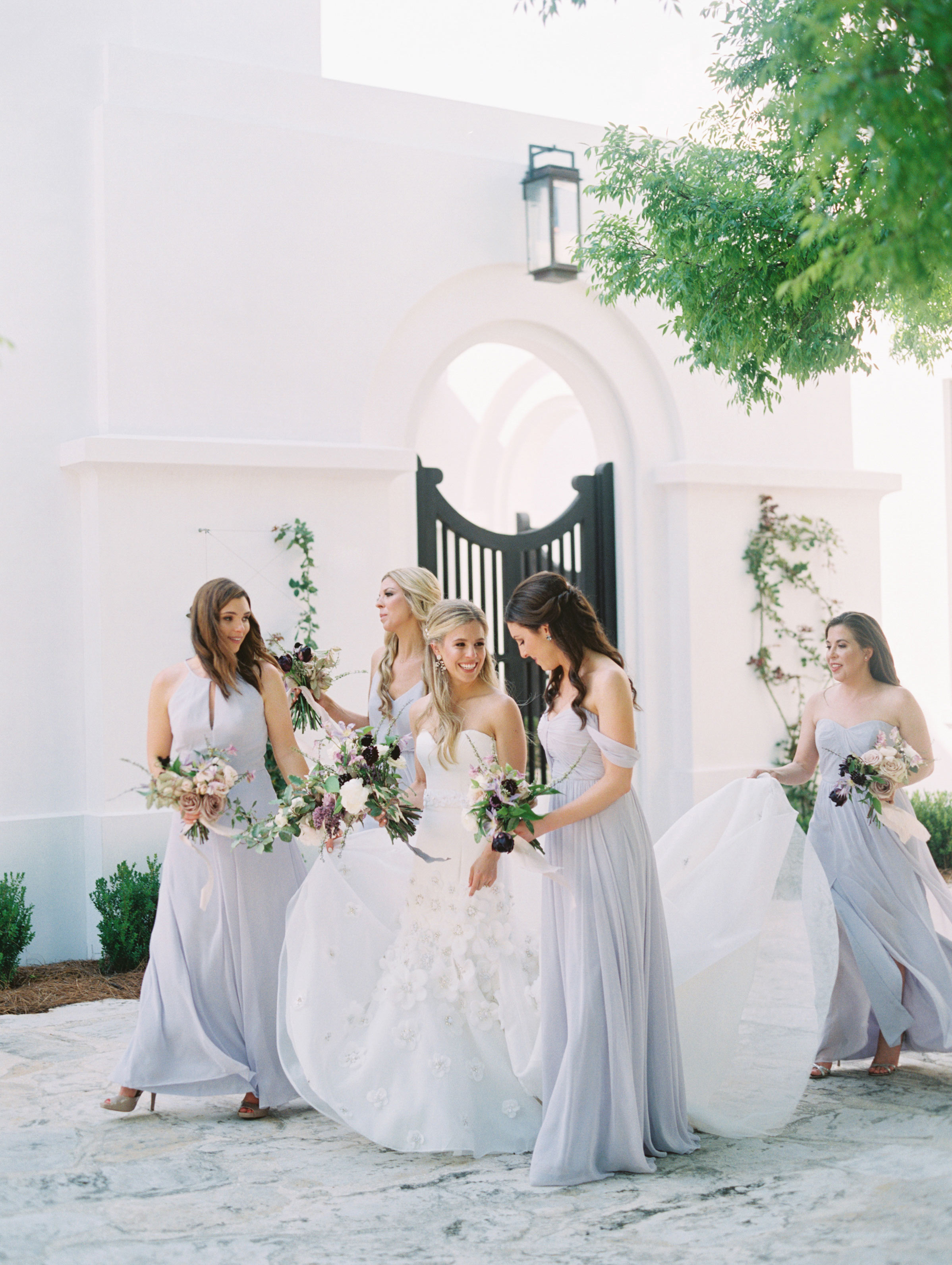 leighton craig wedding bridesmaids assembling in courtyard