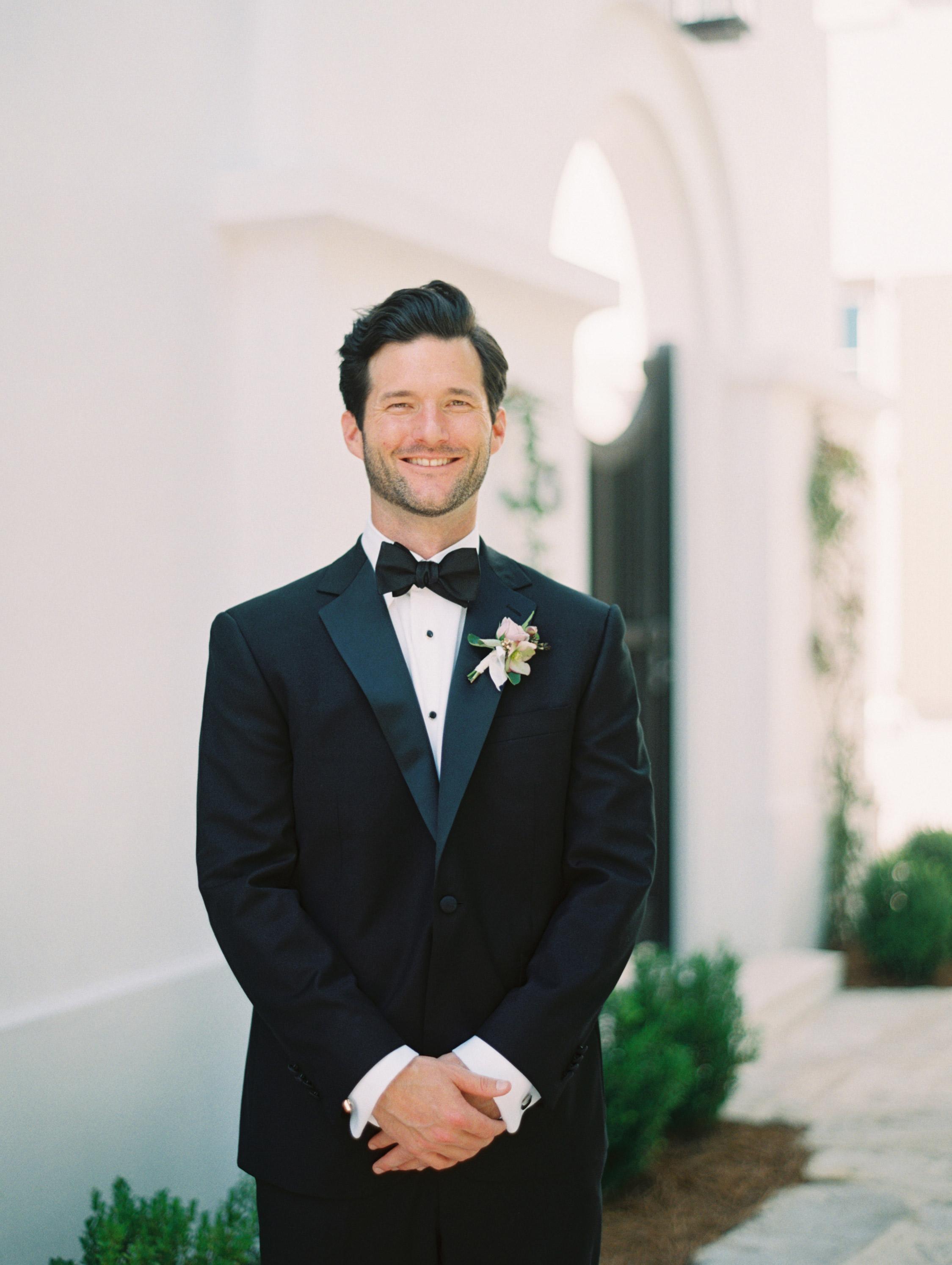 leighton craig wedding groom with arms crossed