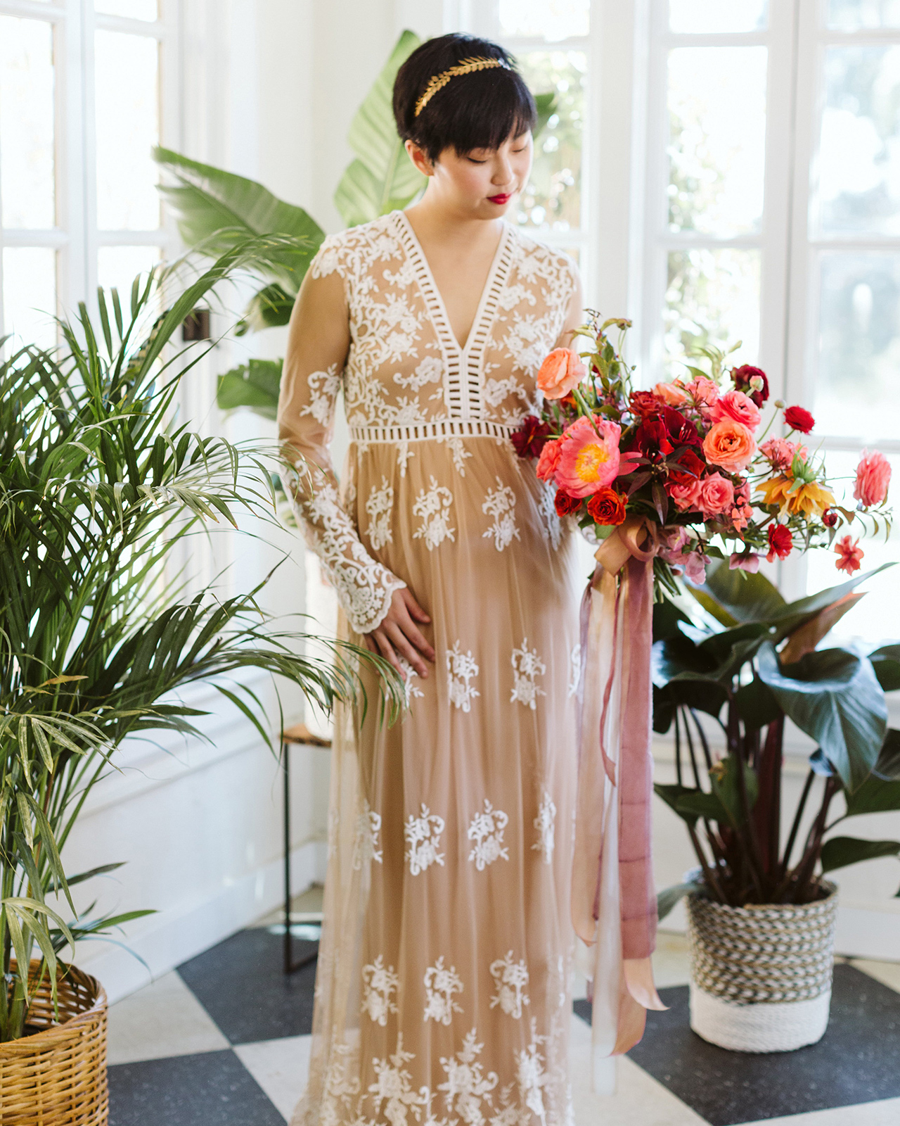 floor-length nude gown v-neckline and long sleeves