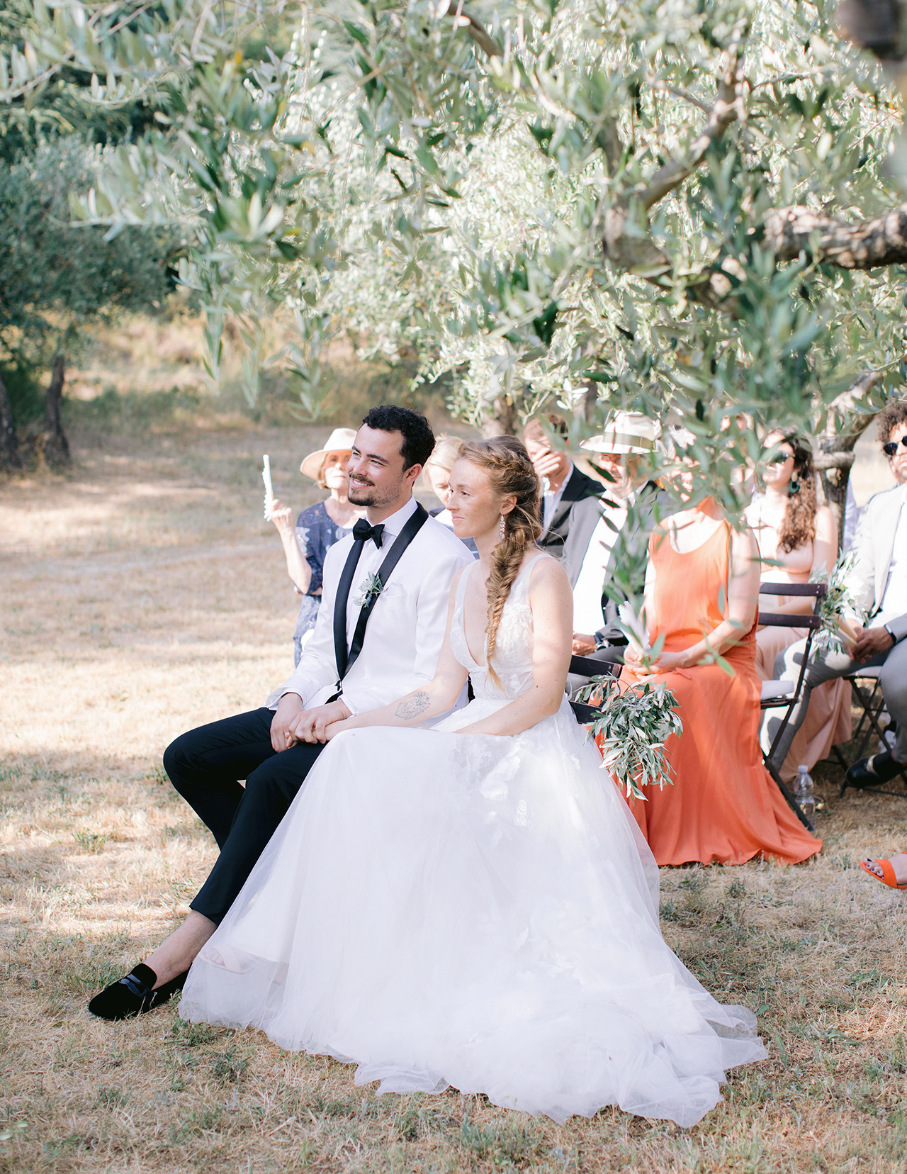 bride groom sitting wedding reception outdoors