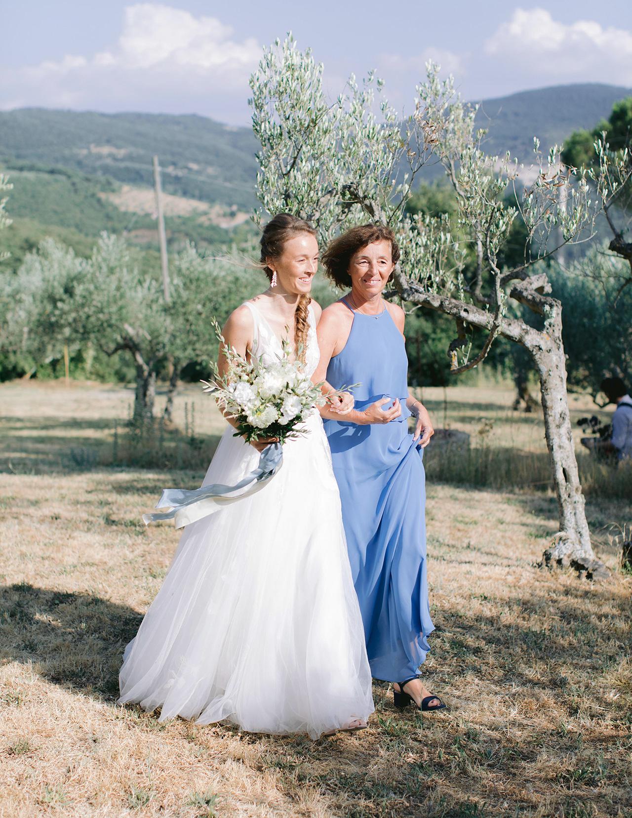 bride mother wedding day outdoor walk