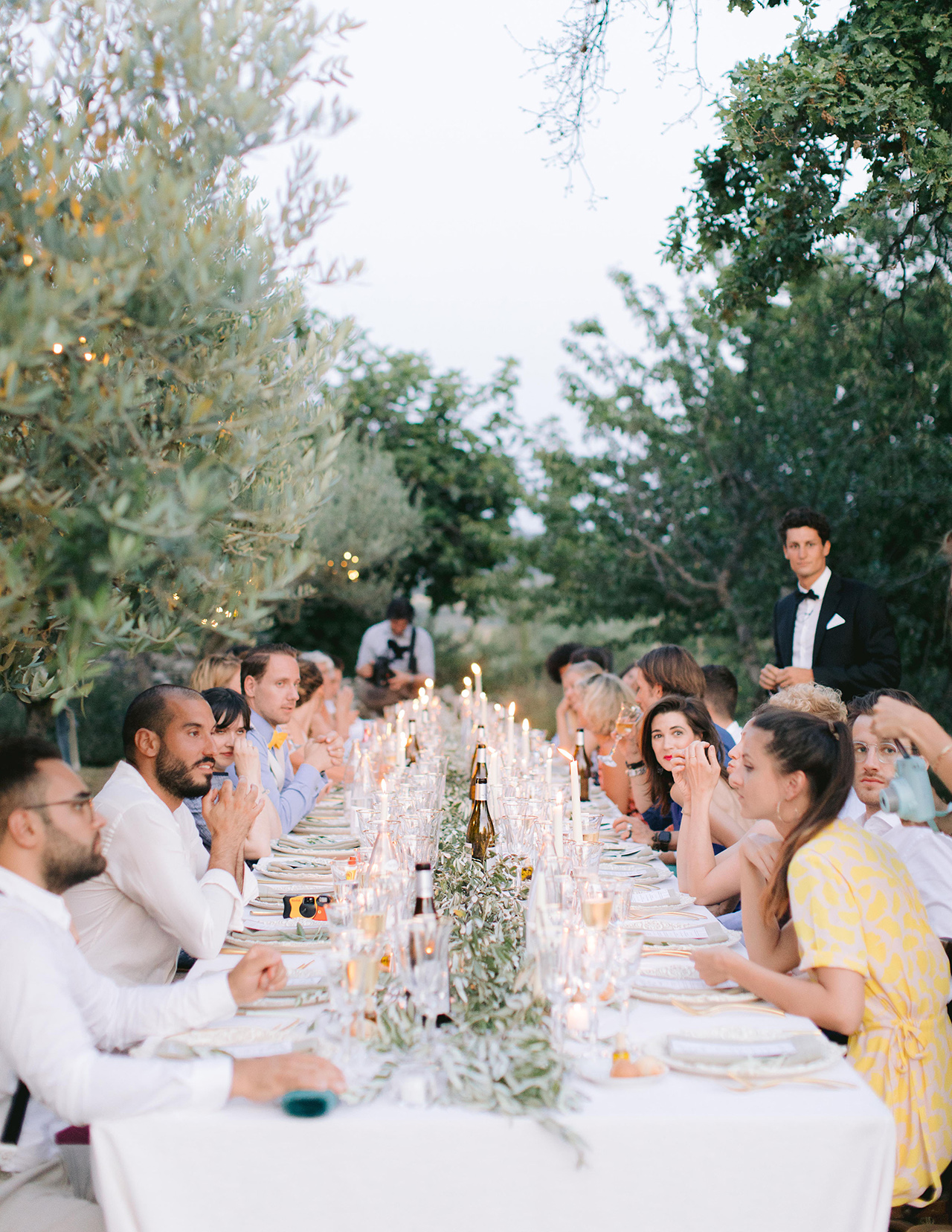 wedding reception outdoor diner party white olive branch table setting