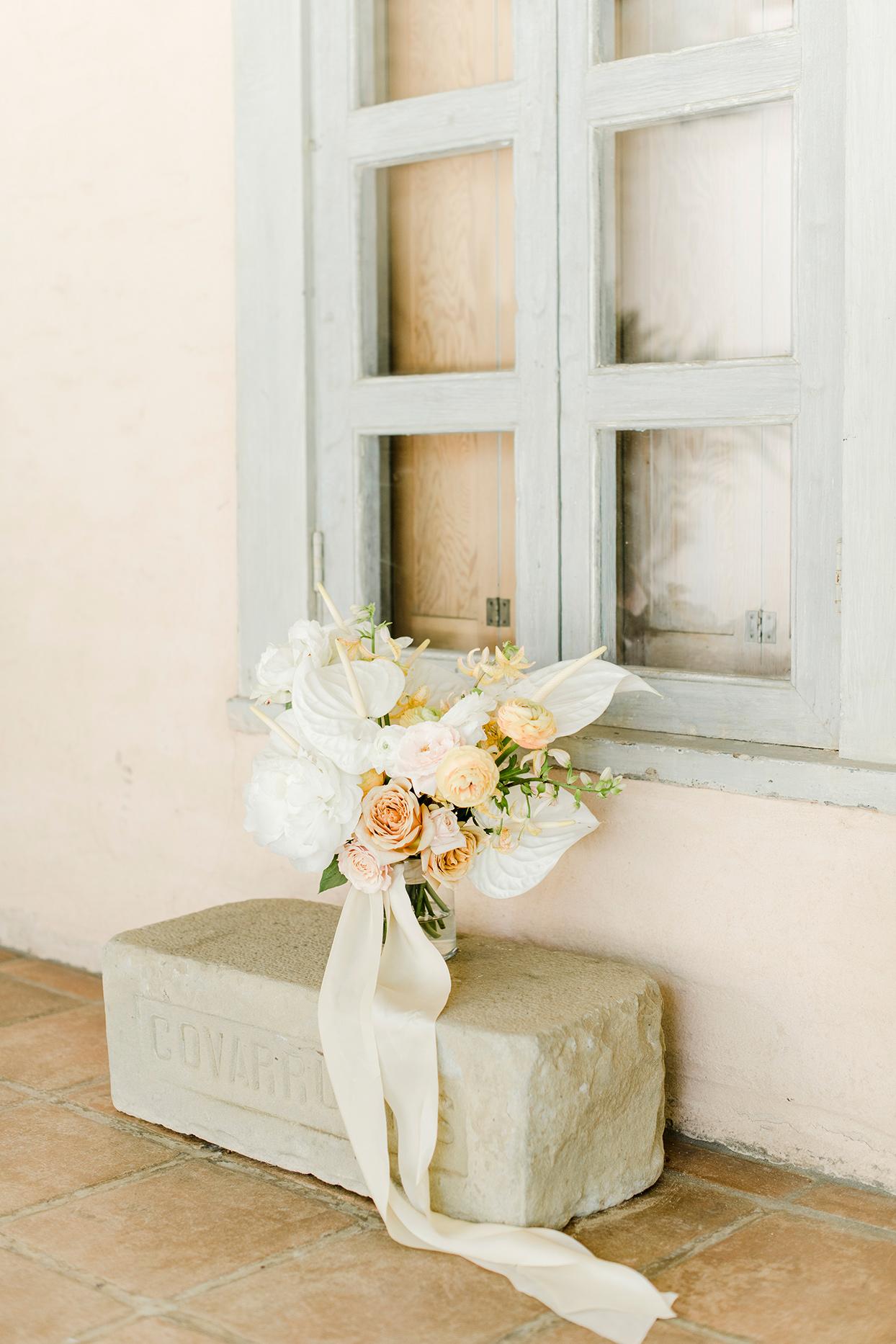 maddie will wedding bouquet on stone bench
