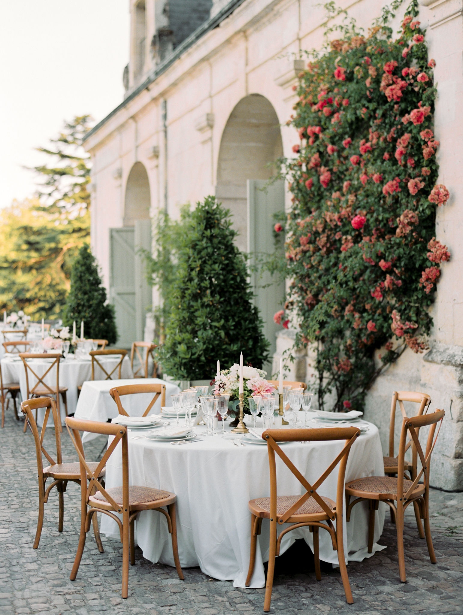 outdoor round reception tables seating seven