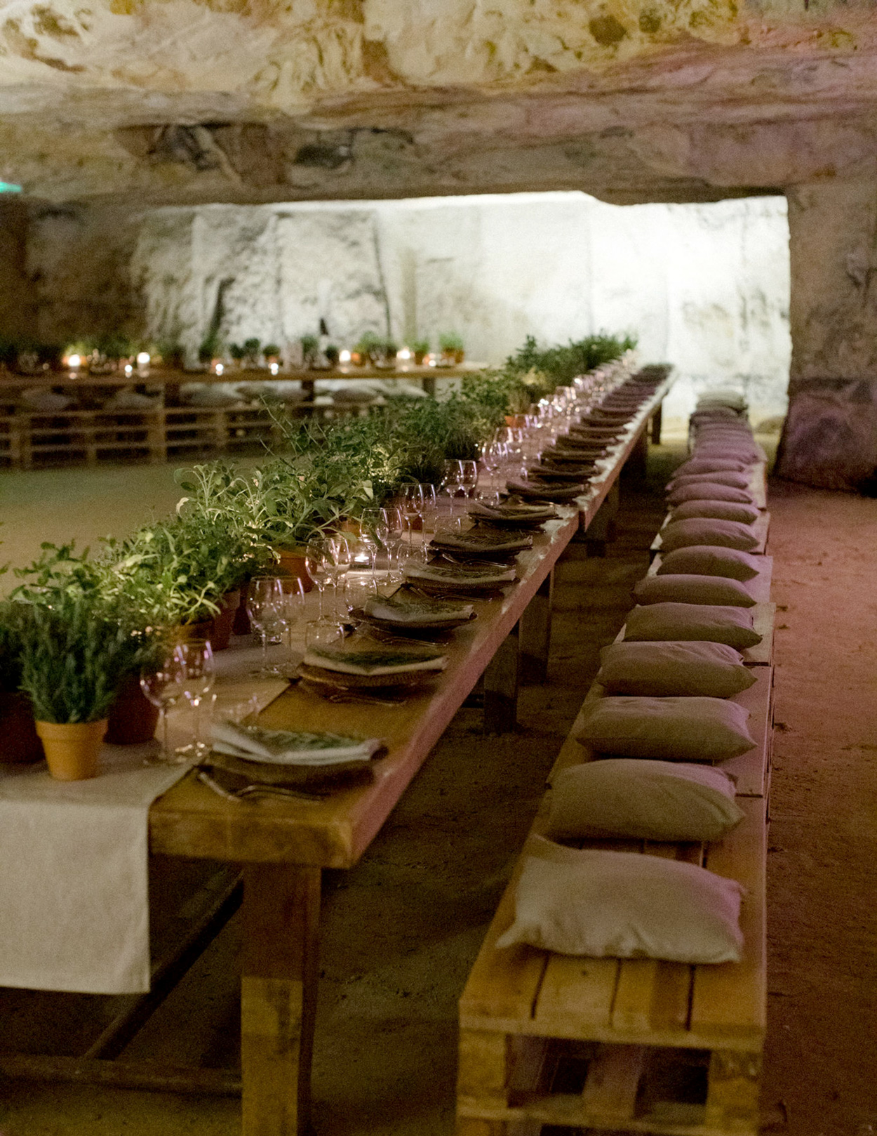 overview rehearsal dinner wooden tables benches with cushions