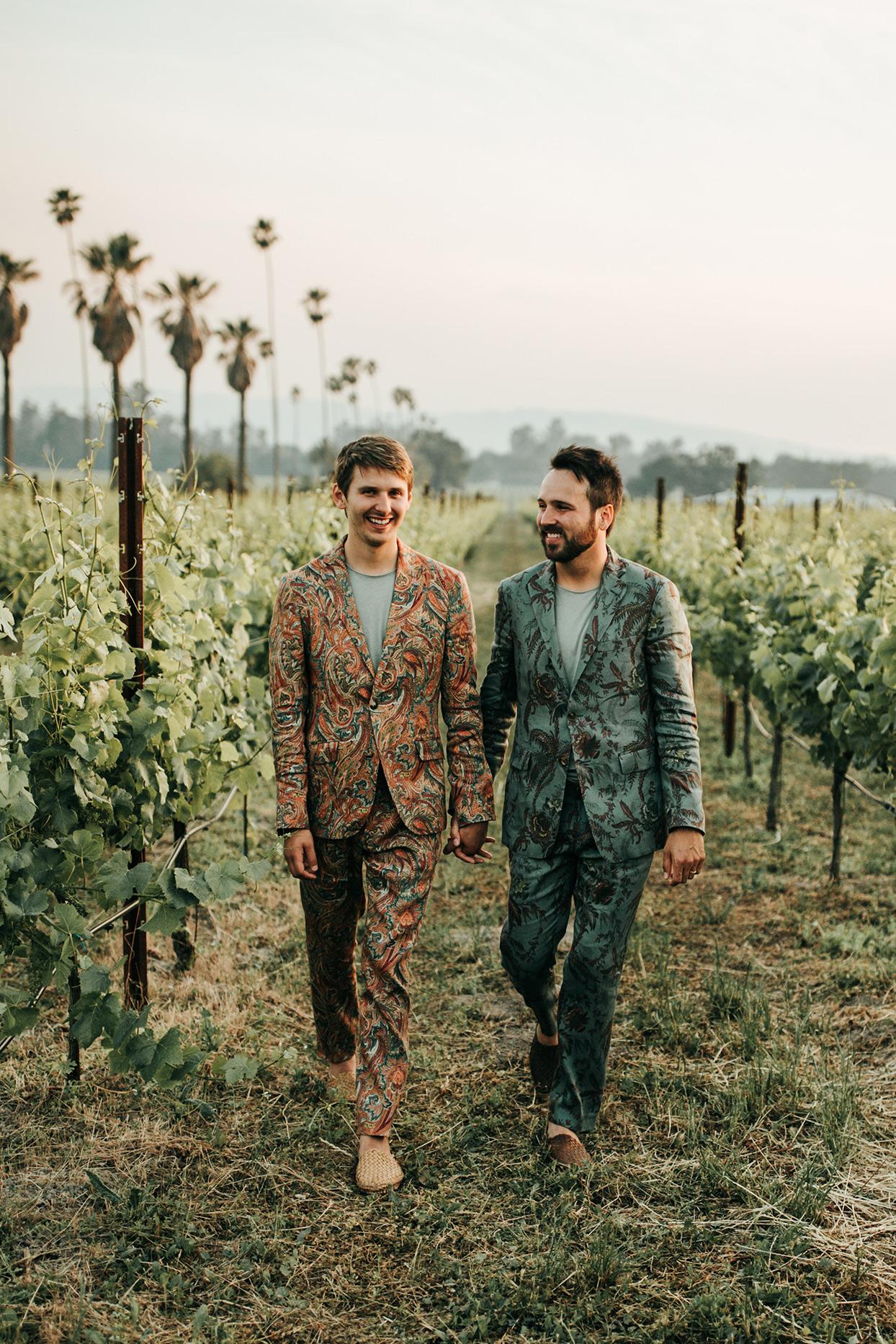 austin alex wedding couple walking through vineyard