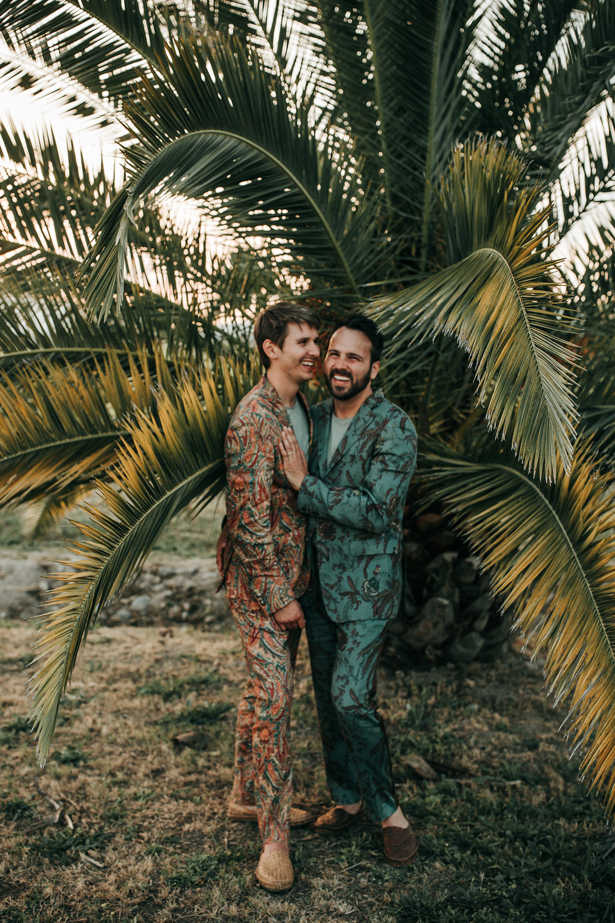 austin alex wedding couple wearing patterned suits in front of palm trees