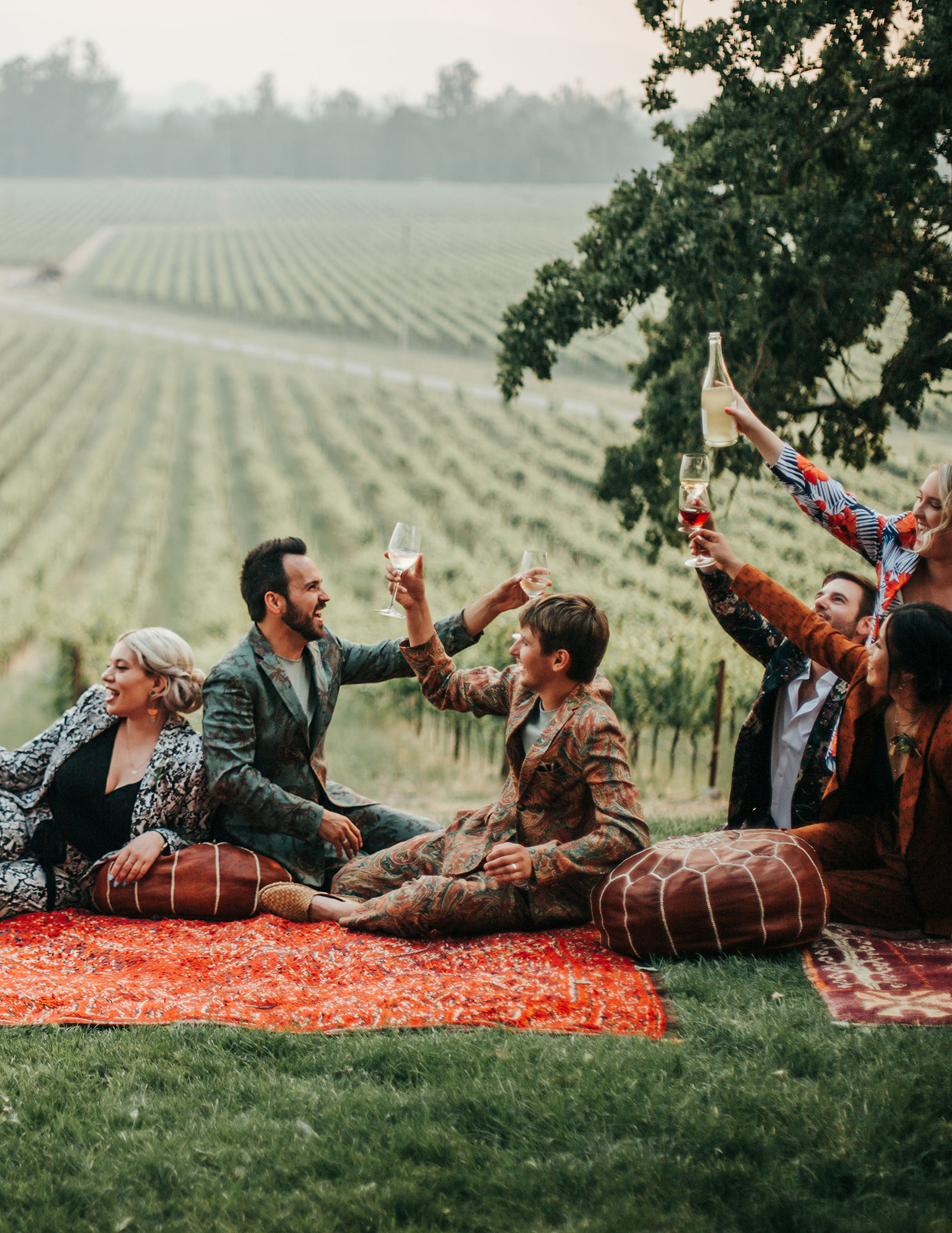austin alex wedding couple toasting on Moroccan rugs