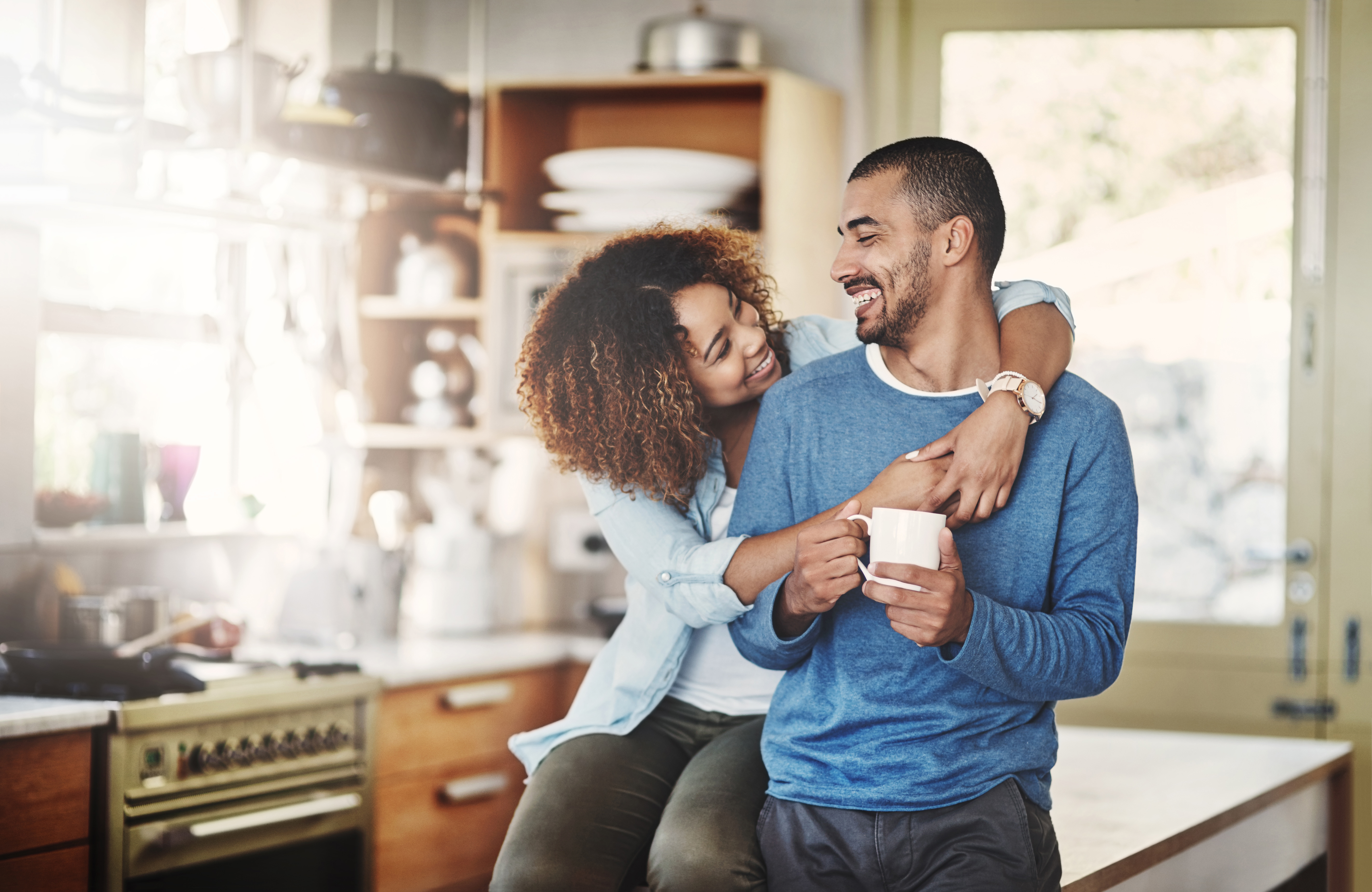 couple in kitchen looking happy