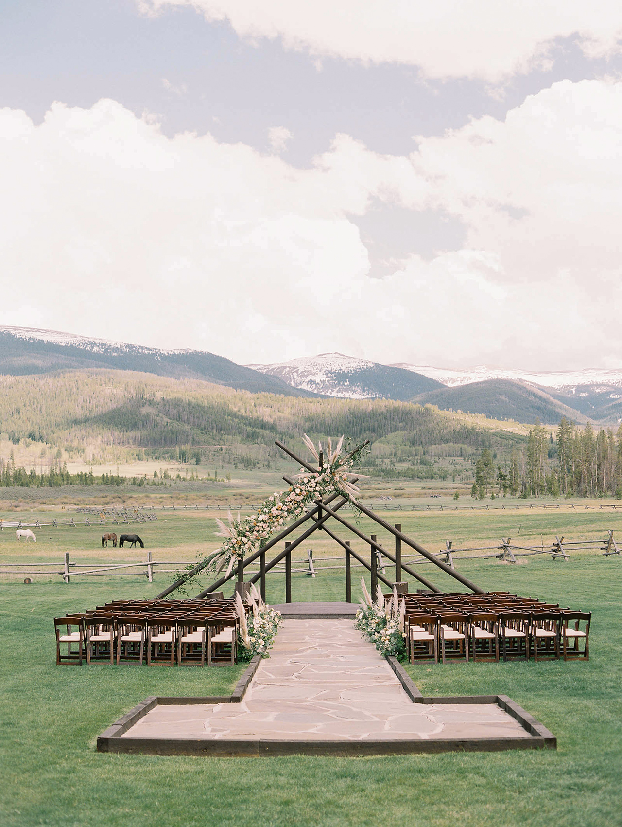 wedding ceremony wooden teepee structure mountain view