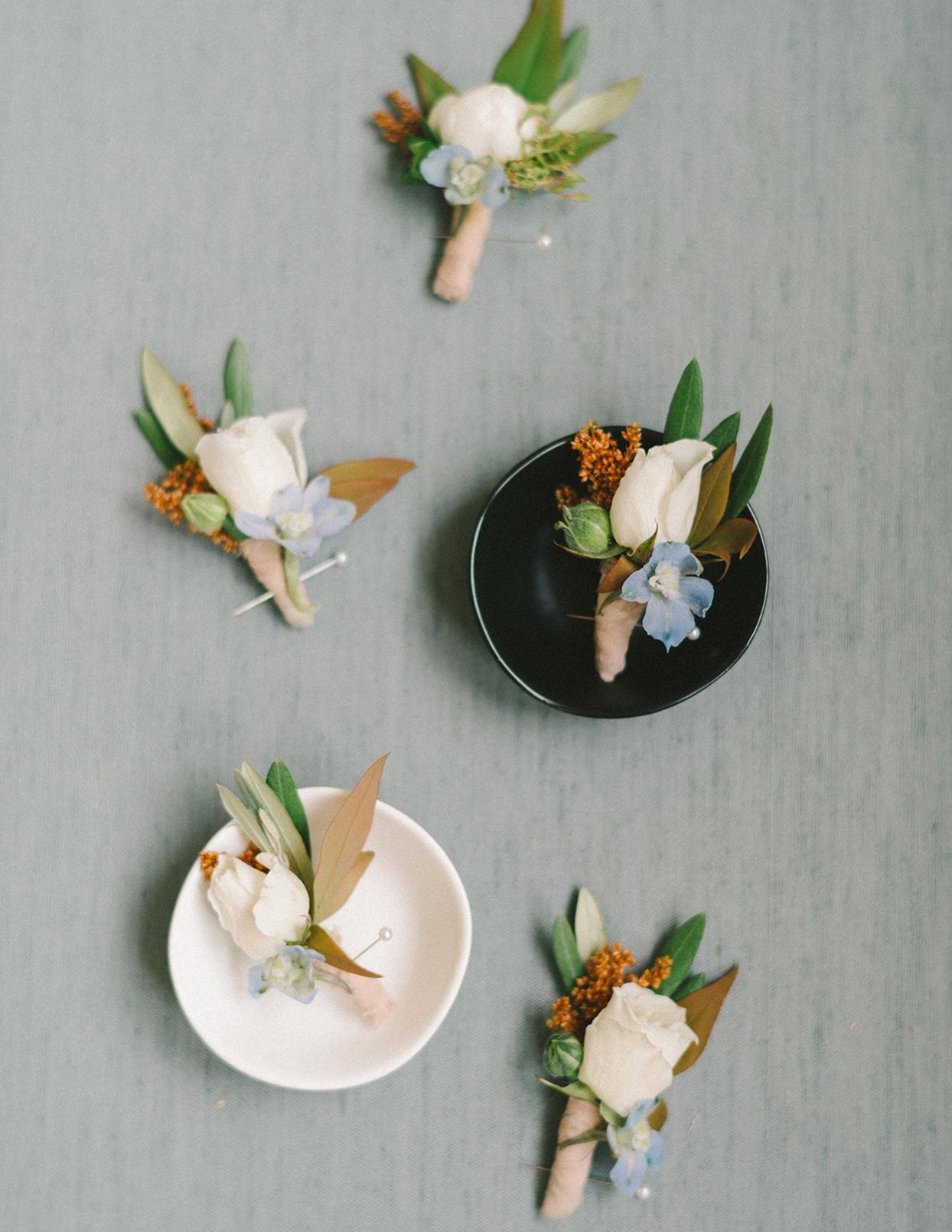 ericka meechaeyl wedding boutonnieres on decorative dishes
