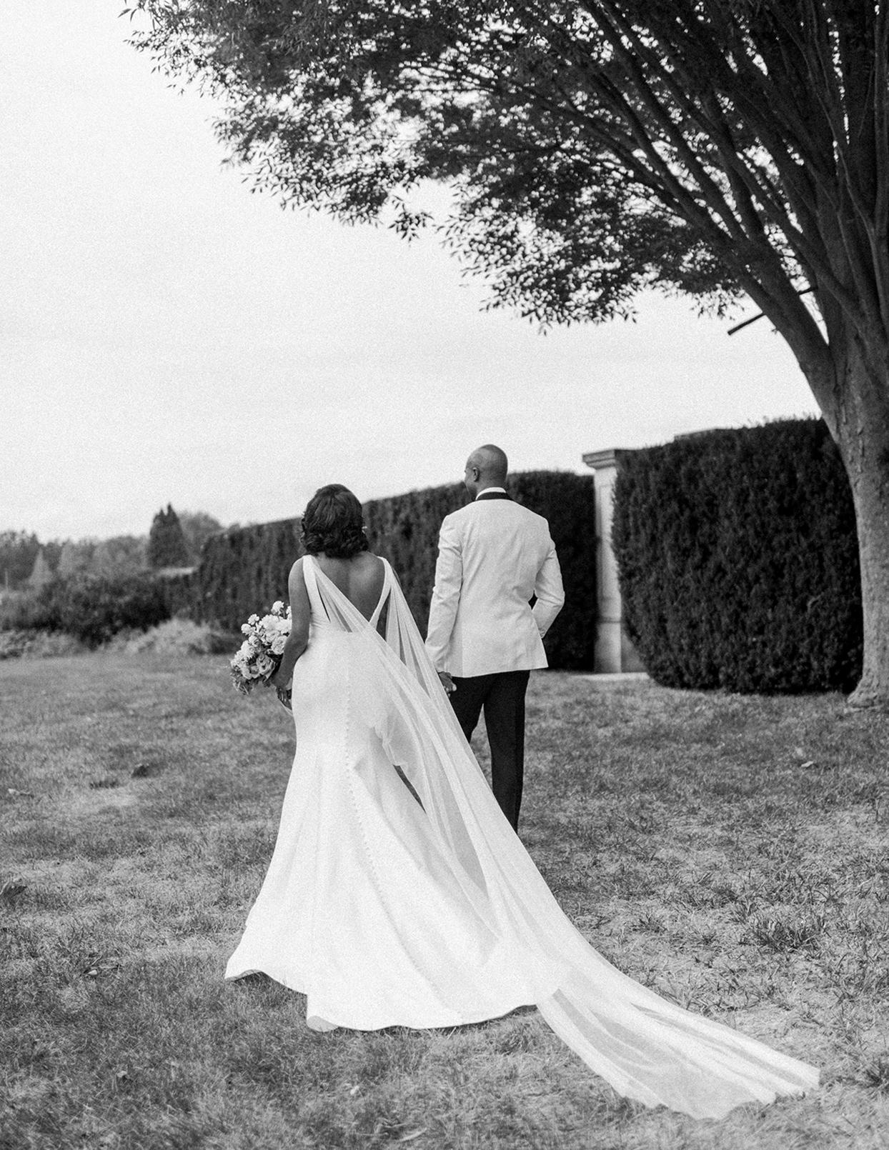ericka meechaeyl wedding couple walking in garden