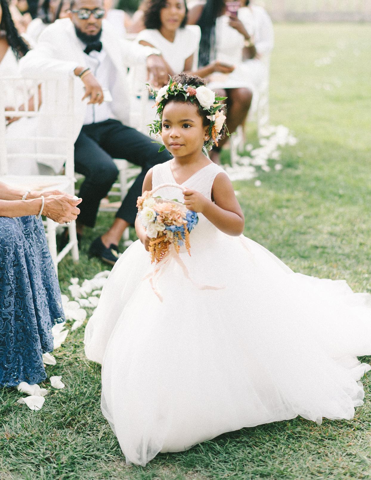 ericka meechaeyl wedding flower girl walking down aisle