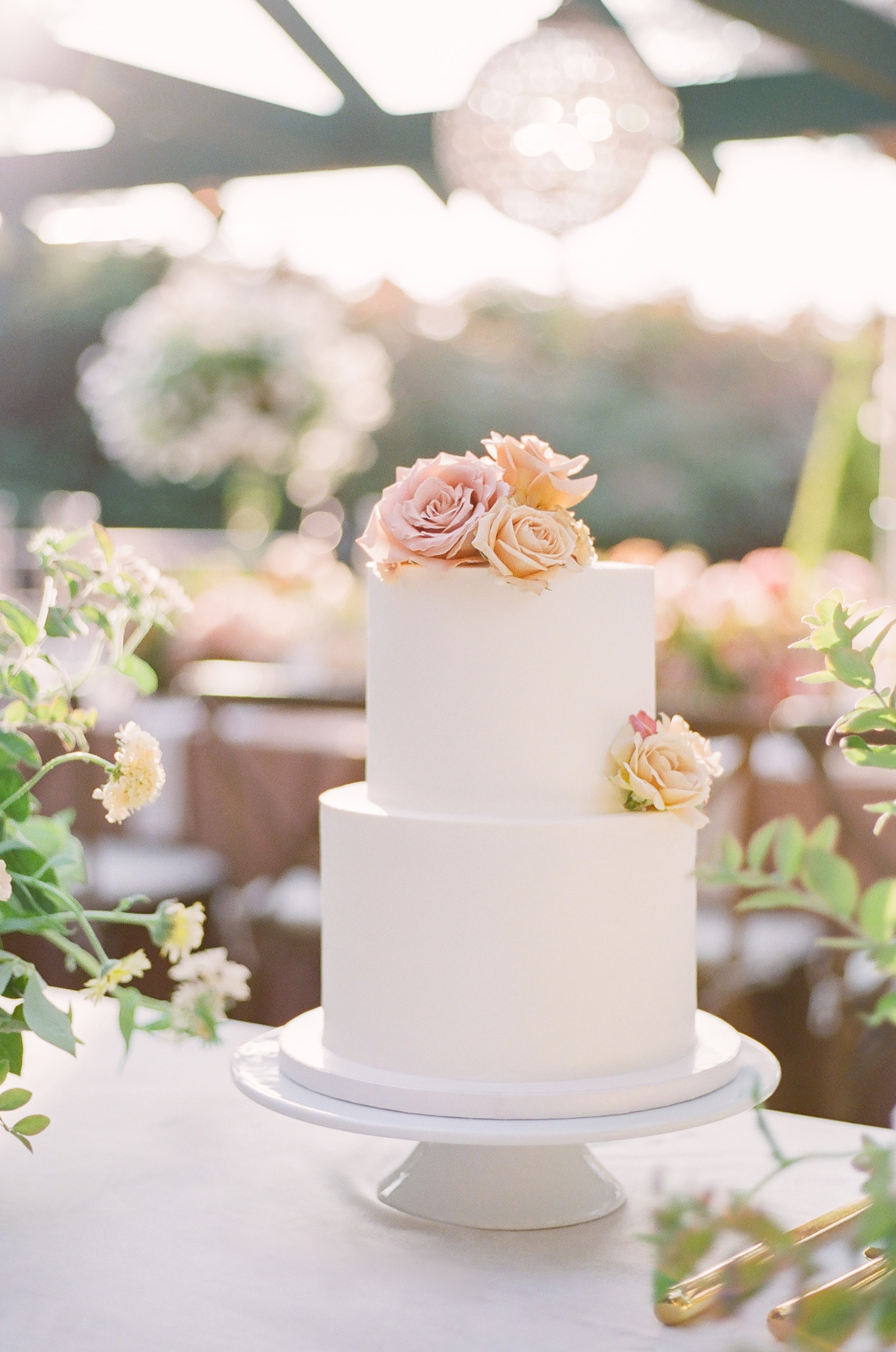 evelyn sam wedding 2-tier white cake with floral accents