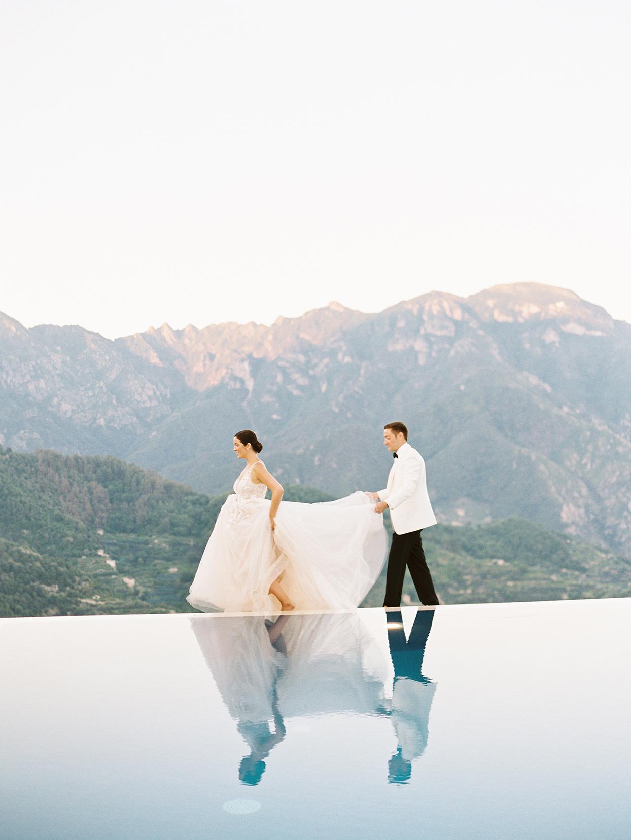 jacqueline david wedding couple walking by infinity pool