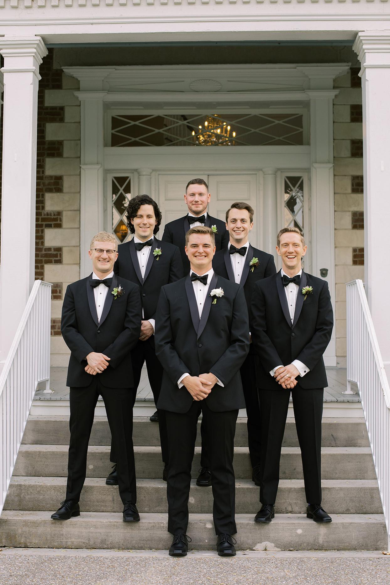 julia doug wedding groomsmen on steps