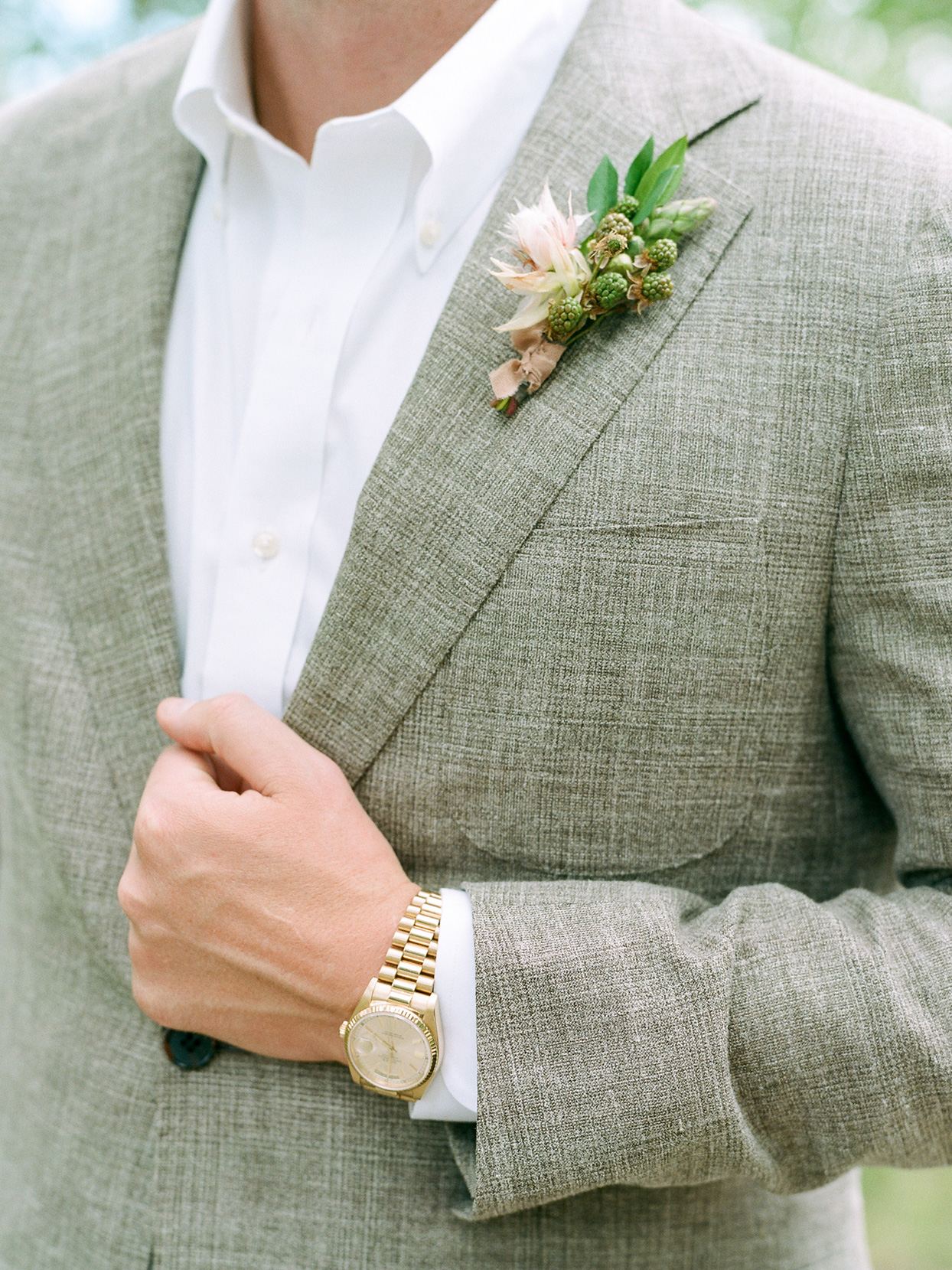 logan conor wedding boutonniere on groom's suit
