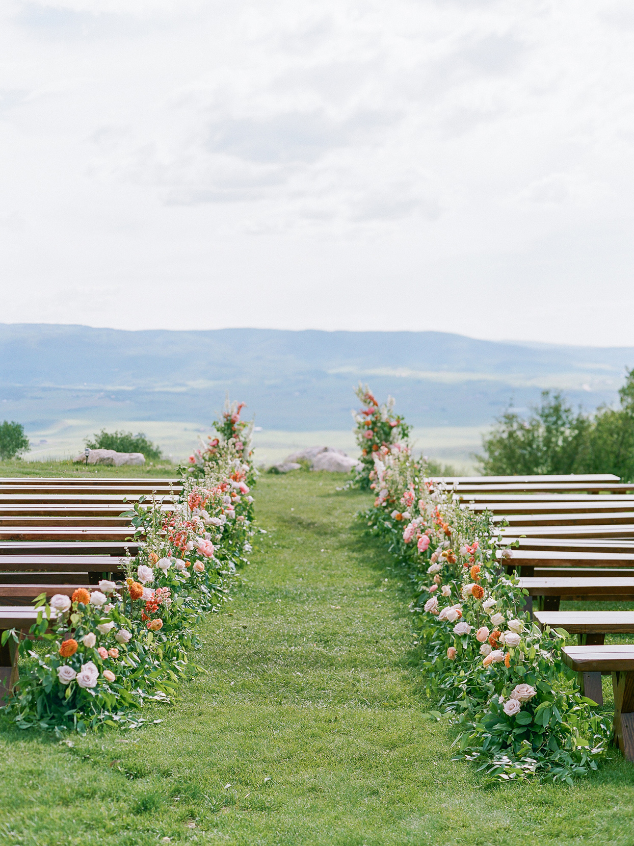 logan conor wedding ceremony location overlooking mountains