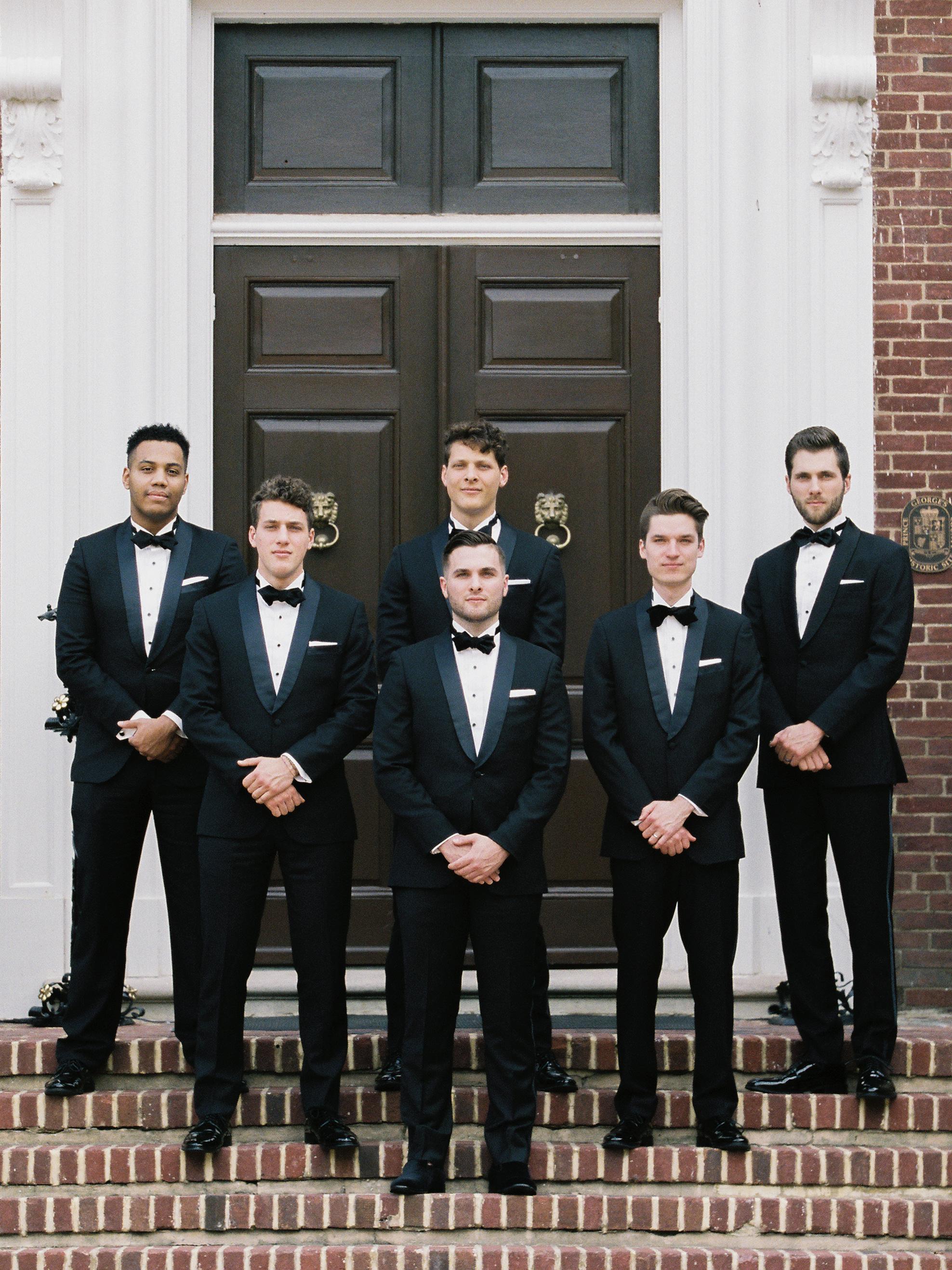 macey joshua wedding groom and groomsmen in black tuxedos
