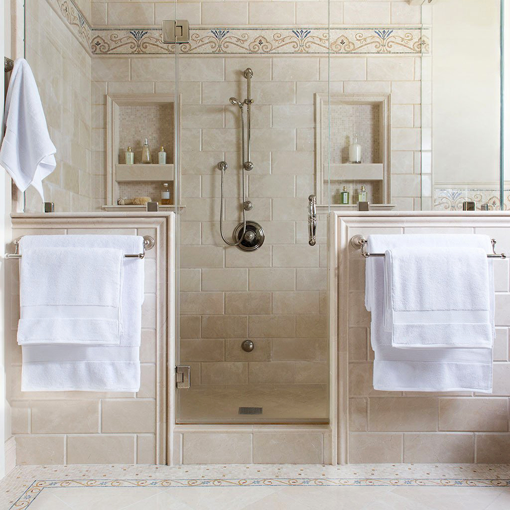 classic white towels in a shower